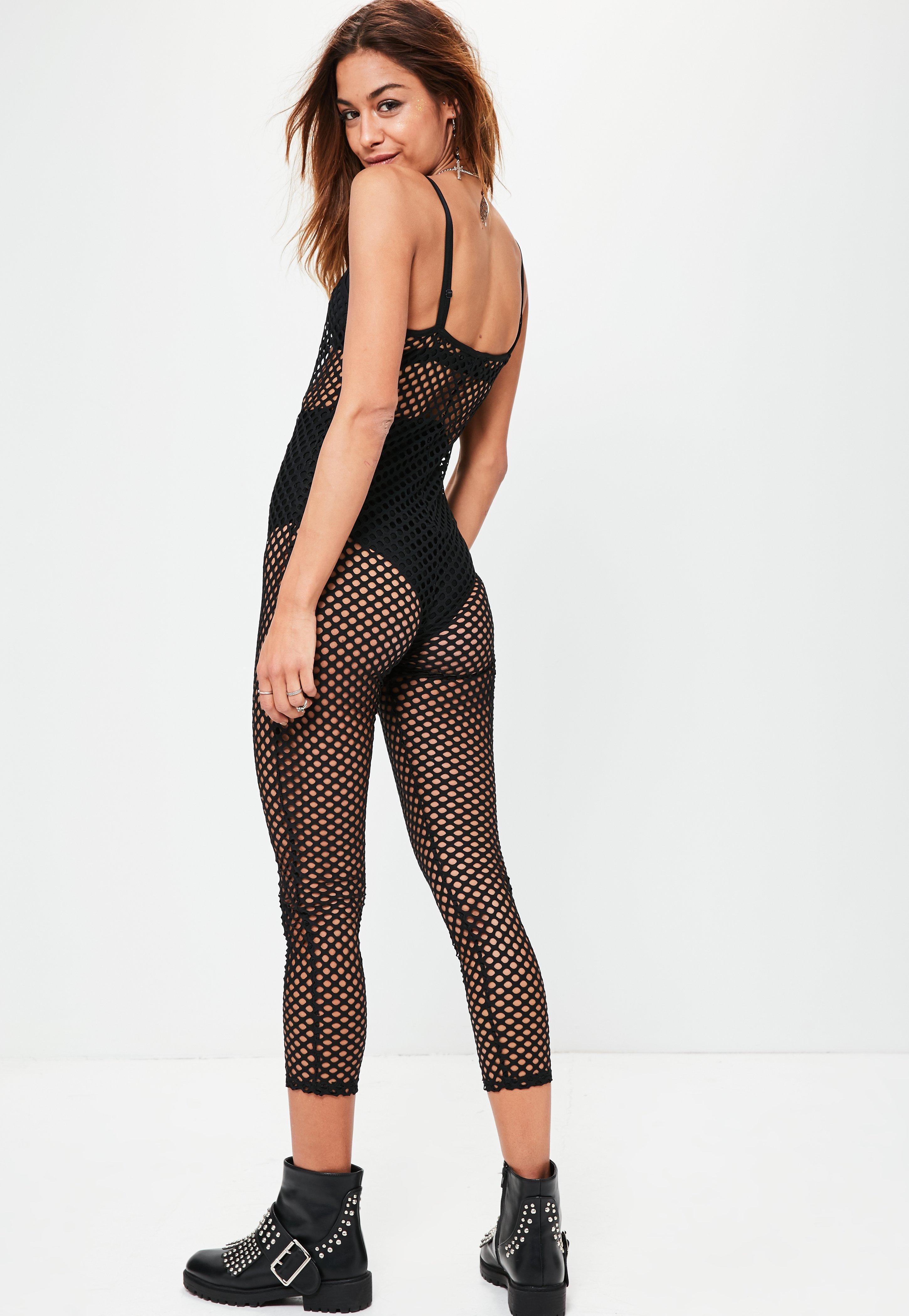 d51451d75250 Lyst - Missguided Black Fishnet Strappy Unitard Jumpsuit in Black