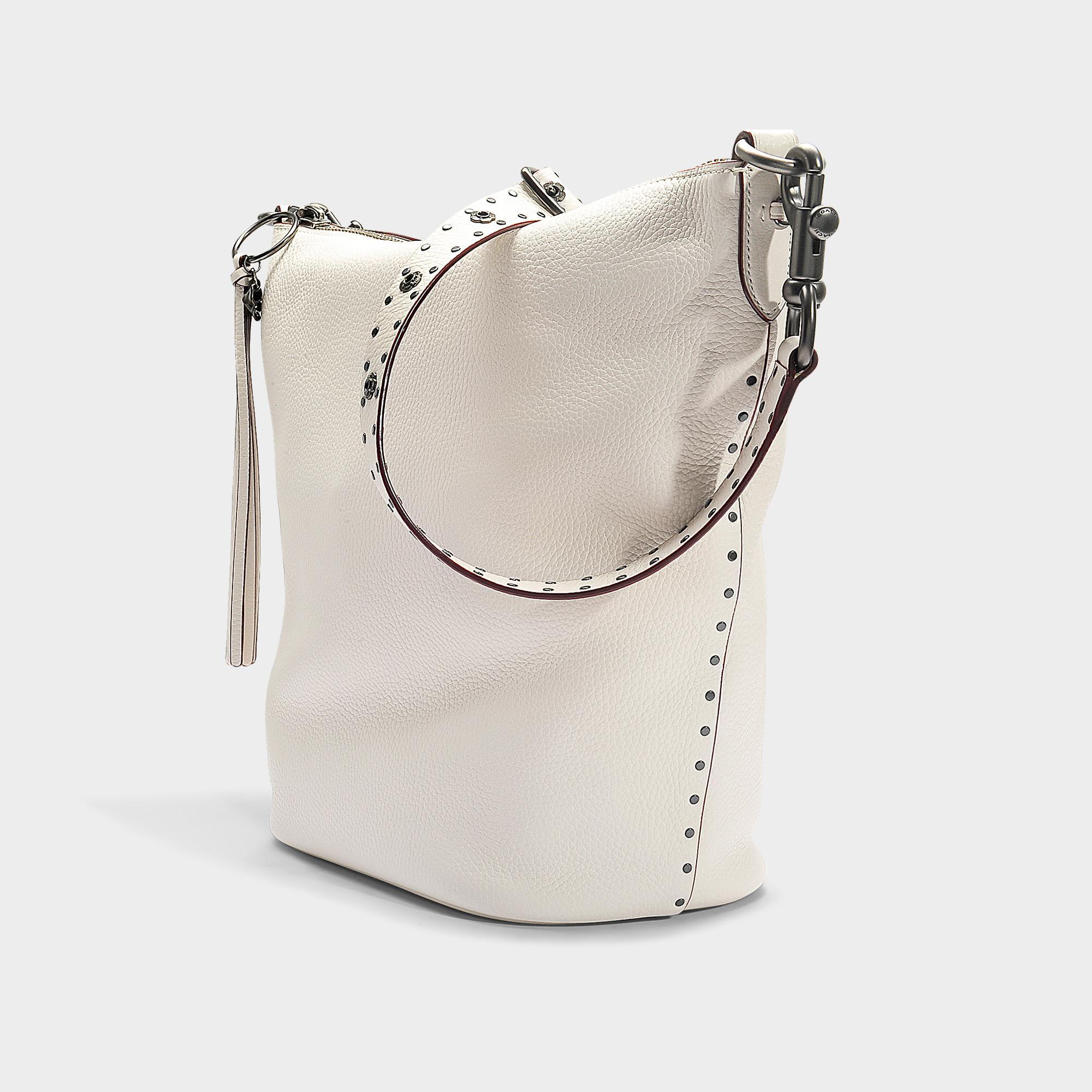 76155c31642d1 Lyst - COACH Border Rivets Duffle Bag In Chalk Calfskin in White