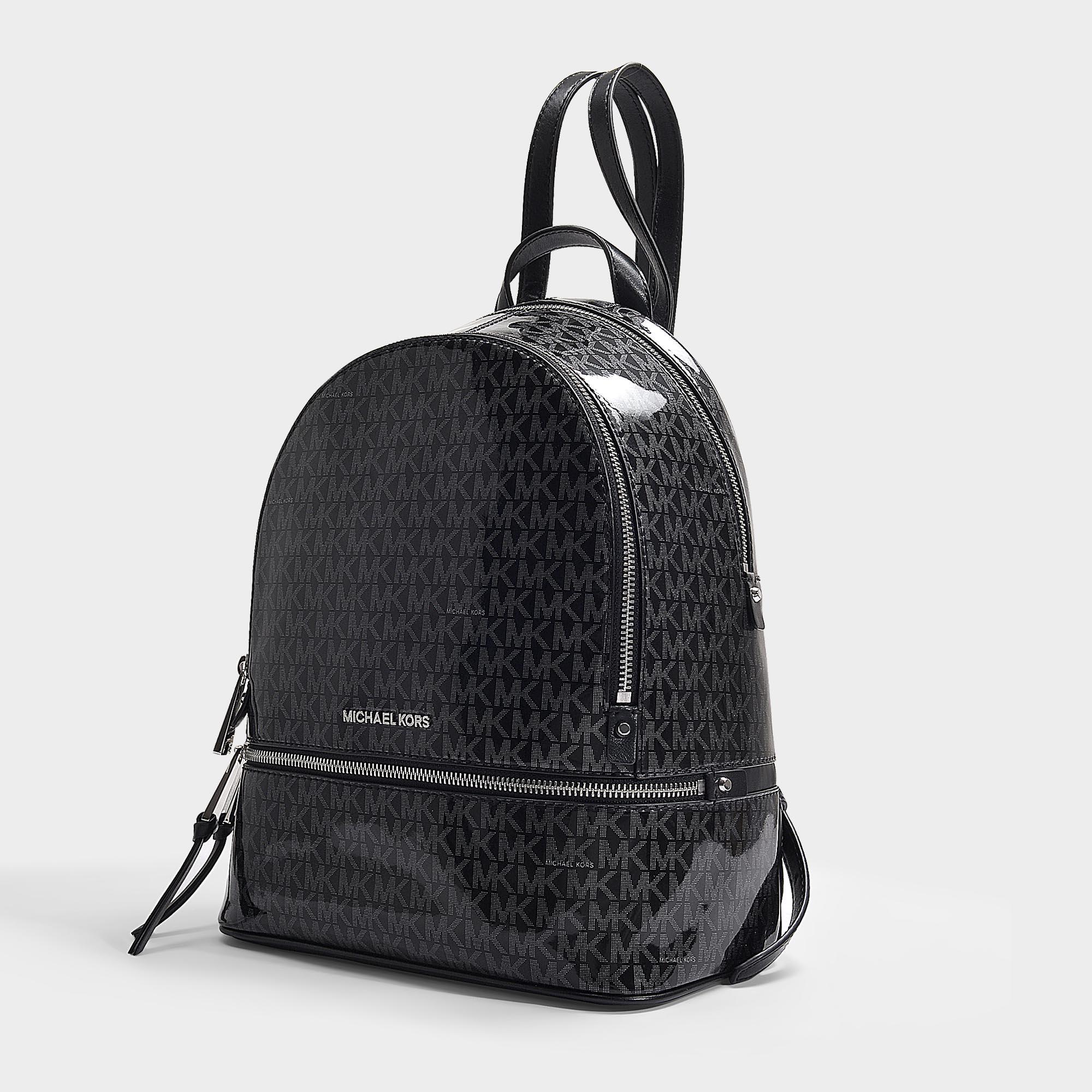 34fb35efe49c34 MICHAEL Michael Kors - Rhea Zip Medium Backpack In Black And Silver Pvc -  Lyst. View fullscreen
