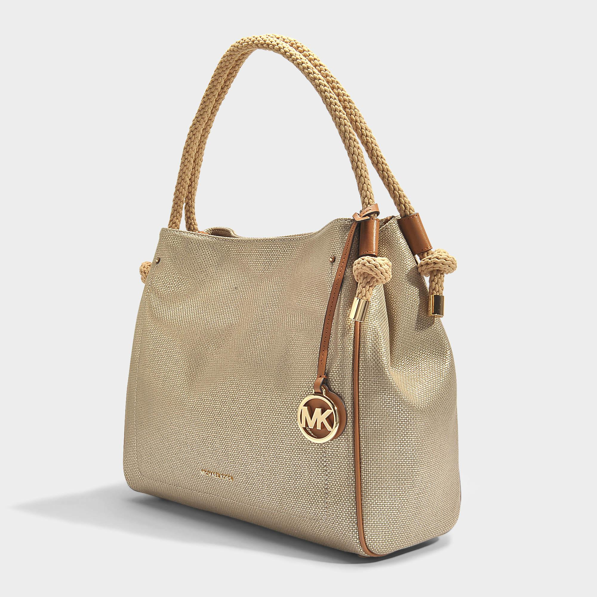 15ab21ed60905 Lyst - MICHAEL Michael Kors Isla Large Grab Bag In Pale Gold ...