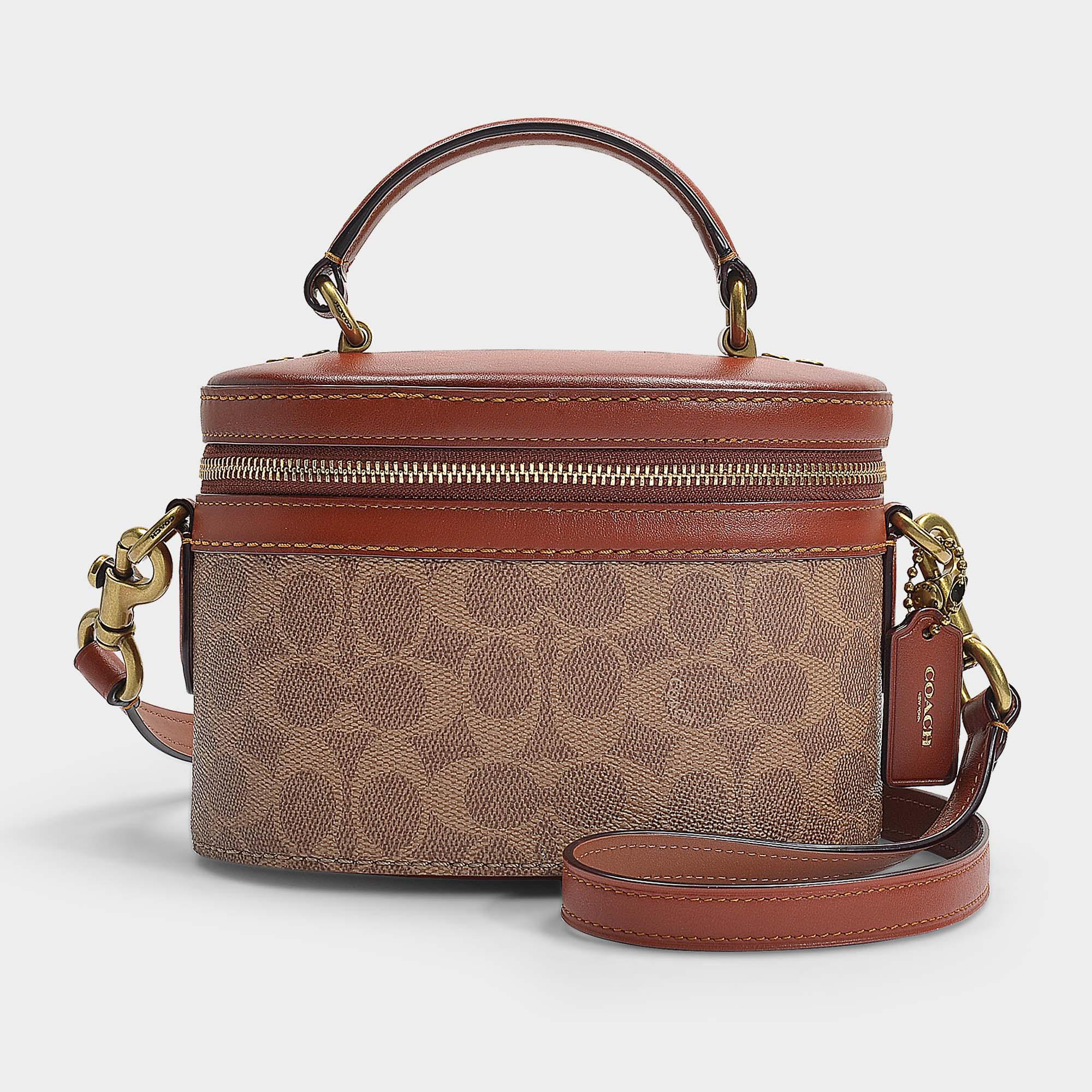 COACH. Women s Brown Signature Trail Crossbody Bag In Rust Signature Coated  Canvas e8f1dd09e2d28