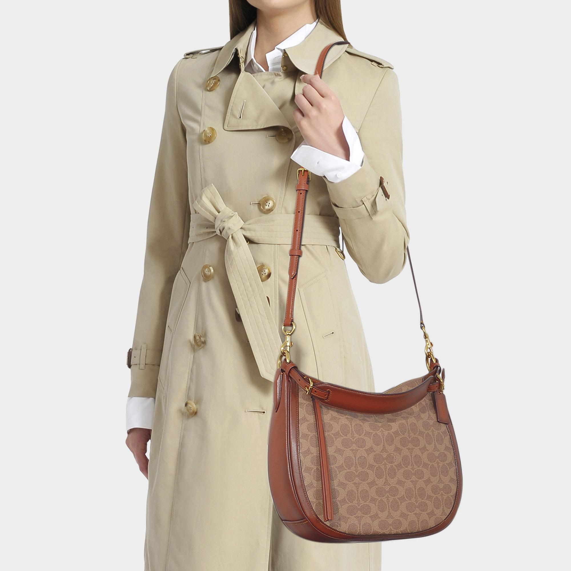 7c59c386f663 COACH - Natural Coated Canvas Signature Sutton Hobo Bag In Brown Canvas -  Lyst. View fullscreen