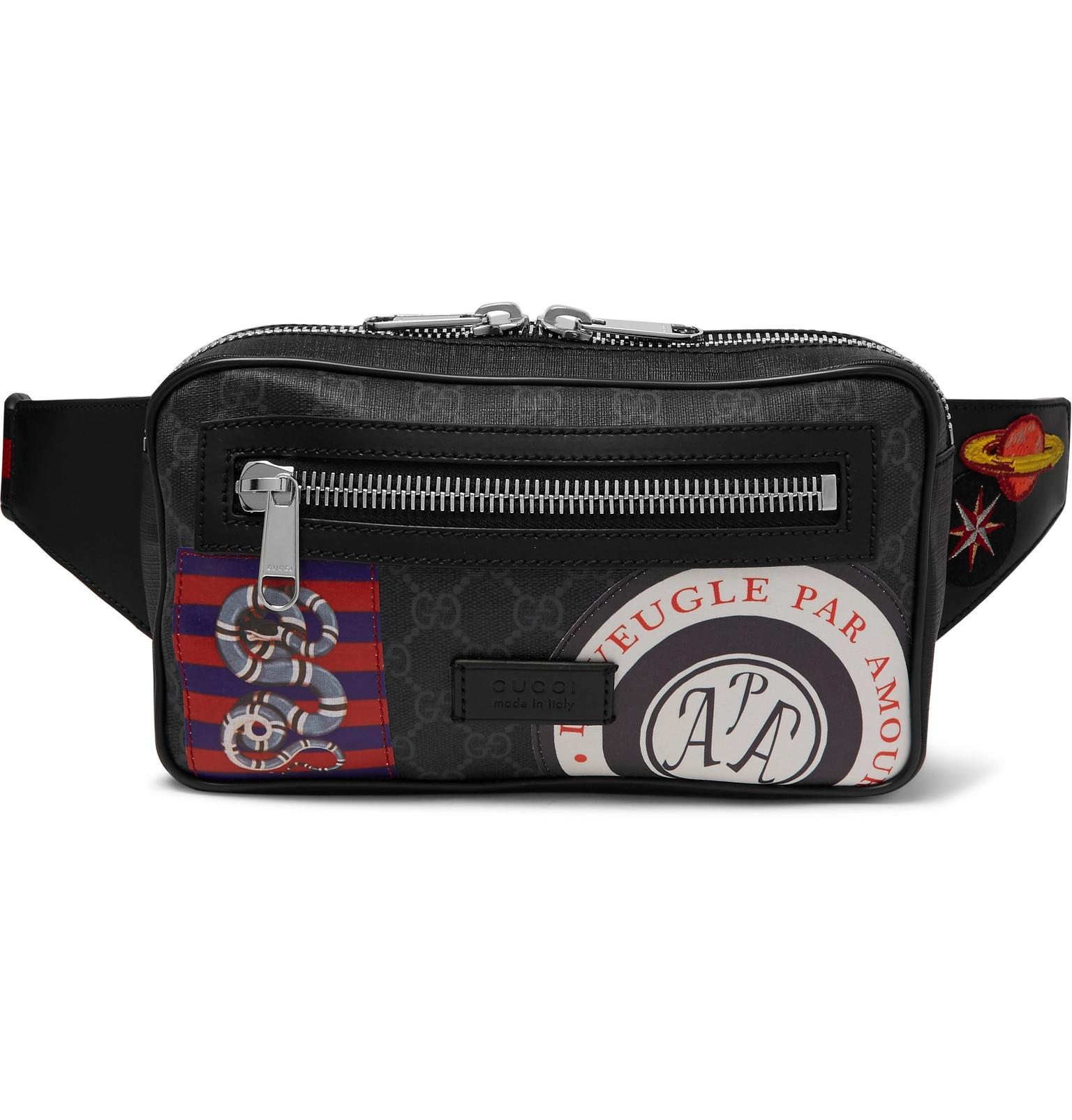 ee47a9922 Gucci. Men's Black Appliquéd Leather-trimmed Monogrammed Coated-canvas Belt  Bag
