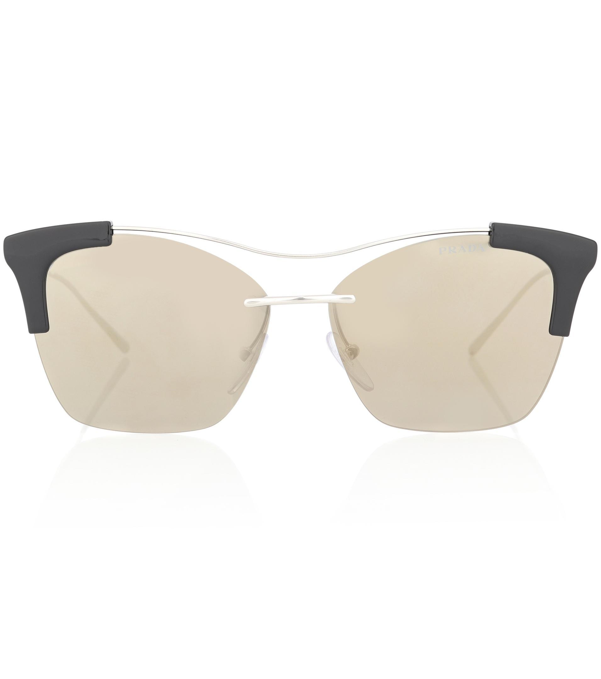 7733cedf527f9 Lyst - Prada Cat-eye Sunglasses in Metallic