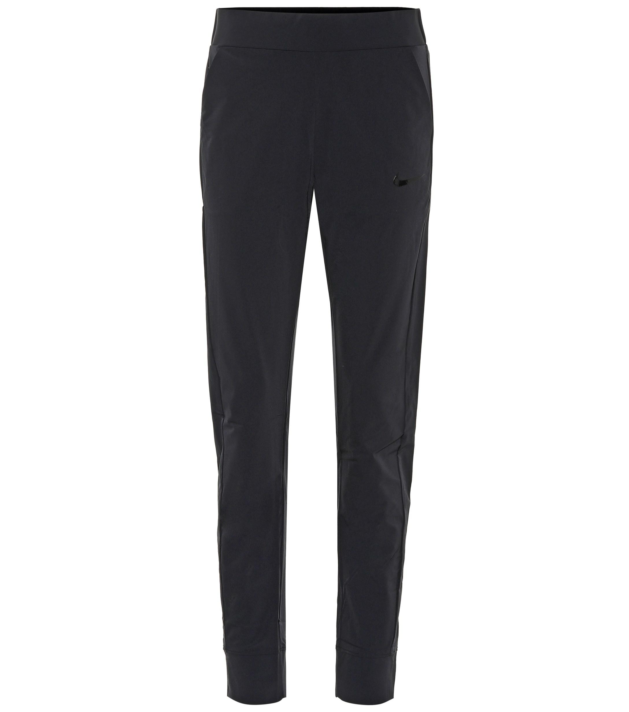 9daba57e9c44 Nike Bliss Lux Mid-rise Training Pants in Black - Lyst
