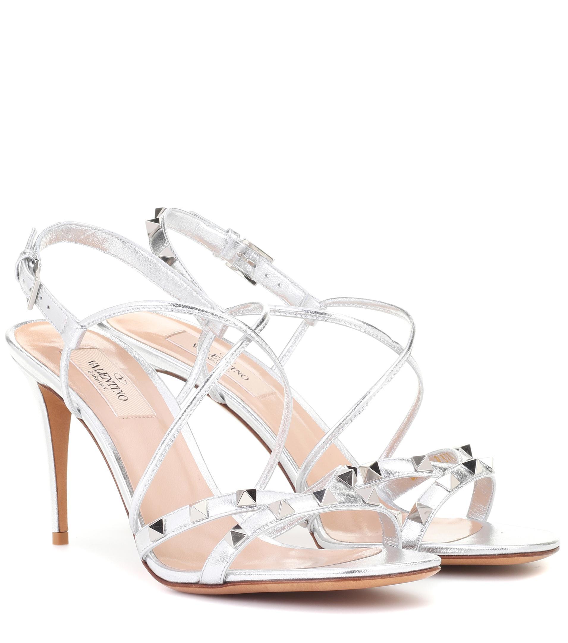 64ce0dd572fa Valentino Garavani Free Rockstud Leather Sandals in Metallic - Lyst