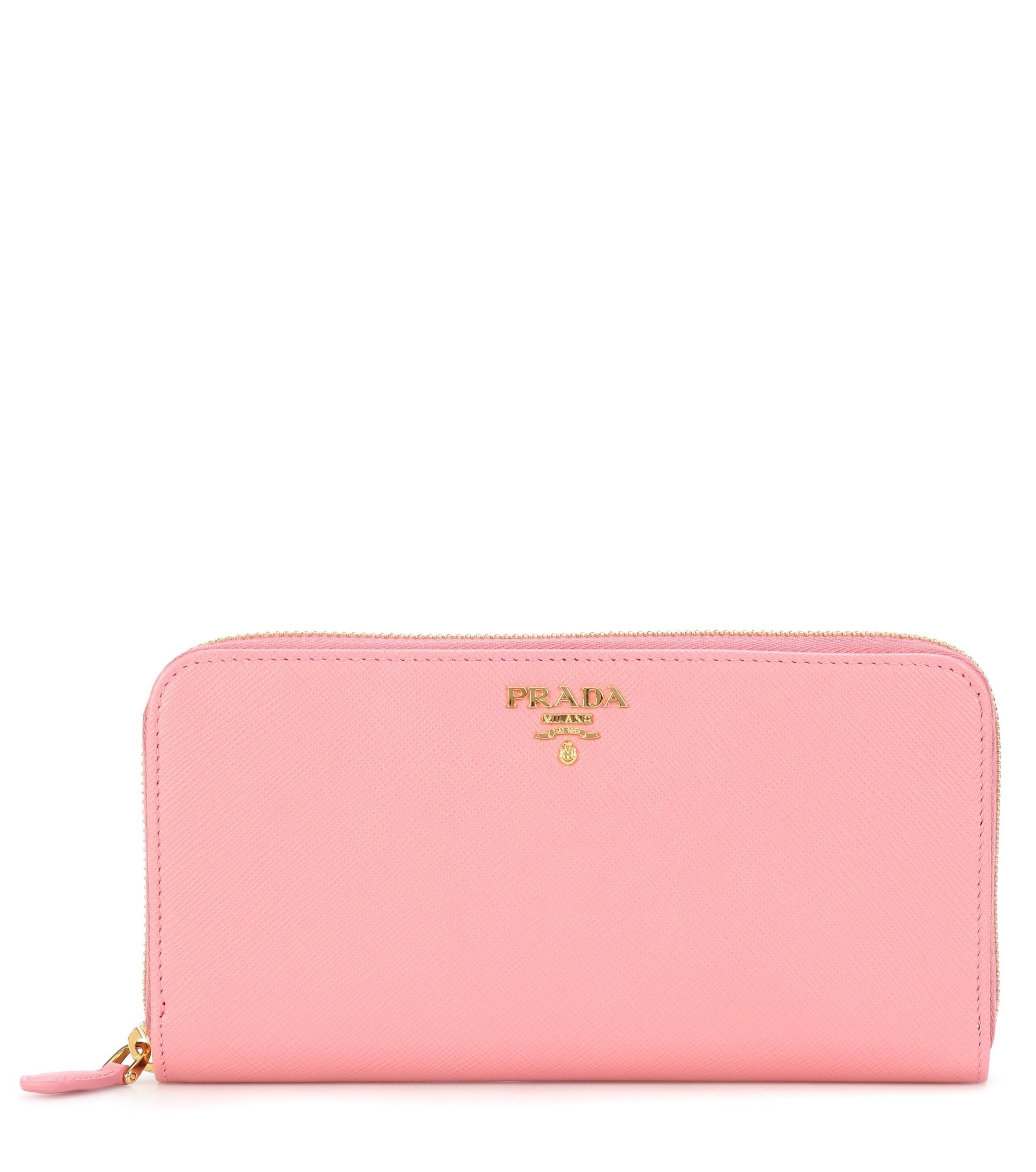 279f107a5ea38d Prada - Pink Saffiano Leather Zip-around Wallet - Lyst. View fullscreen