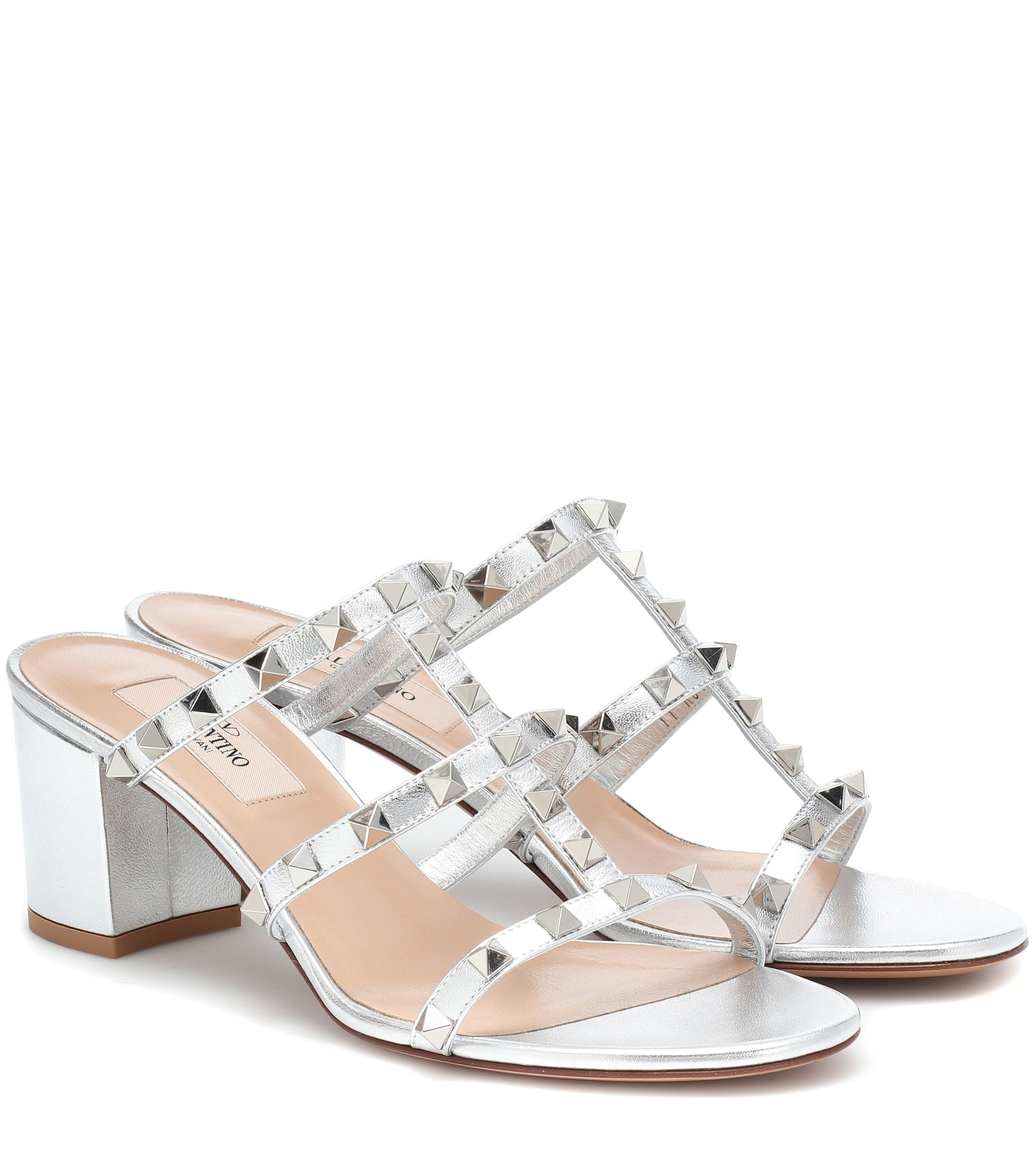 49345f0c5e2 Lyst - Valentino Rockstud Spike Leather Sandals in Metallic