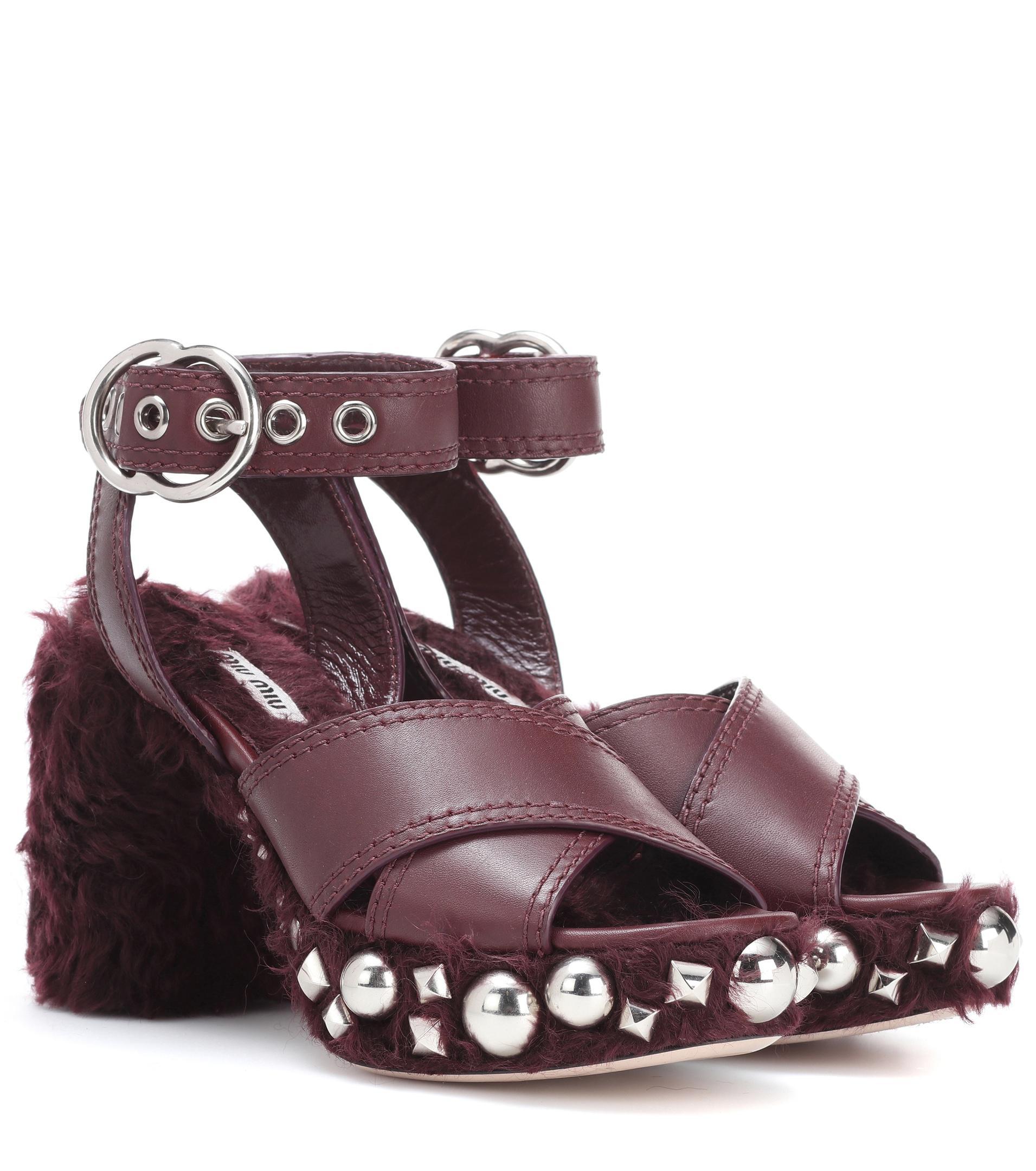 Miu Miu Leather and faux fur sandals KSN1An6G