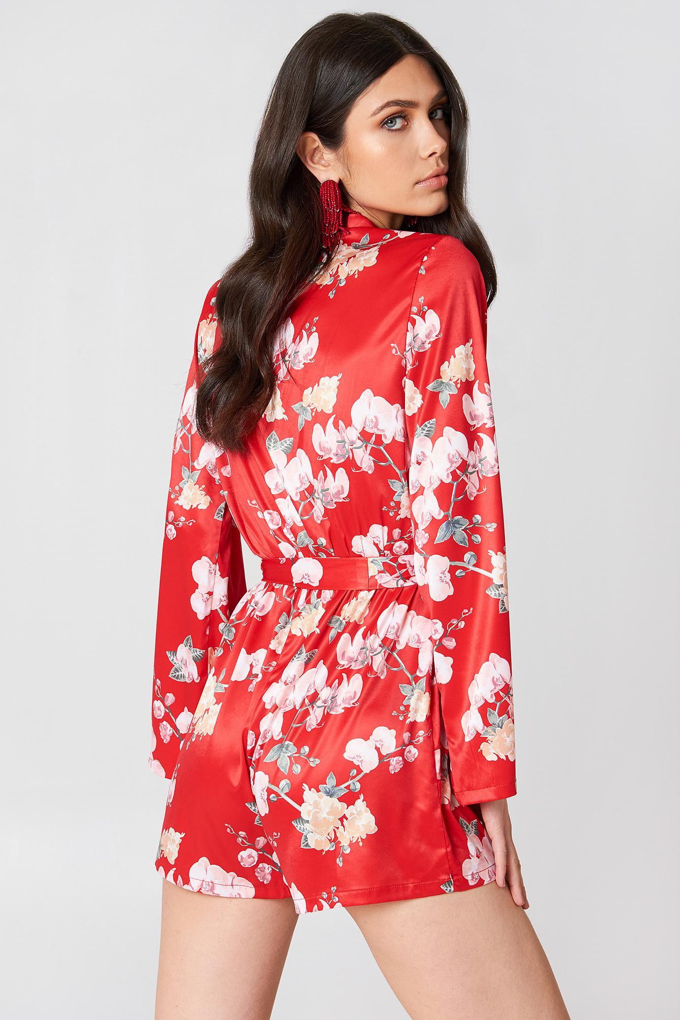 ec560d8fa26 NA-KD - Deep V-neck Satin Playsuit Red Orchid Print - Lyst. View fullscreen