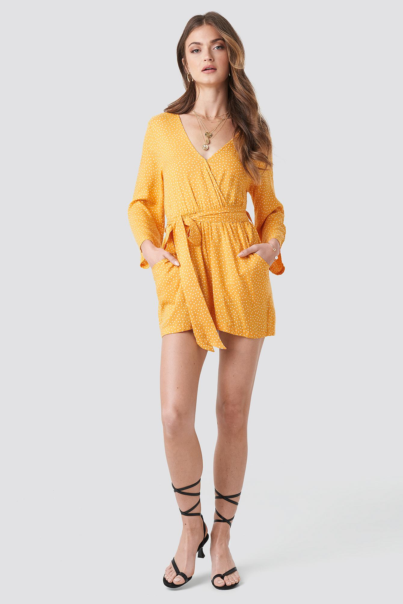 0f91c7ec98a NA-KD - Wrap Playsuit Yellow Dots - Lyst. View fullscreen
