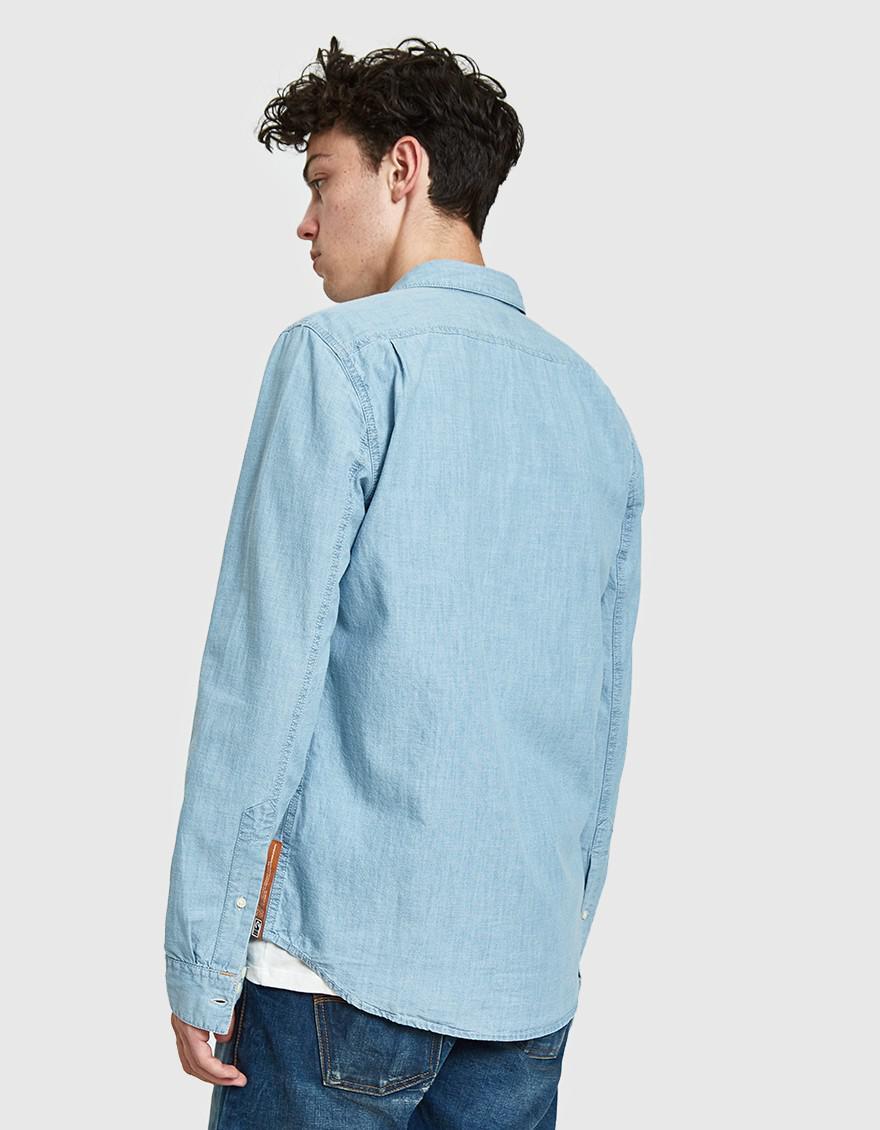 02fbf07e21 Nudie Jeans - Blue Henry Chambray Shirt for Men - Lyst. View fullscreen