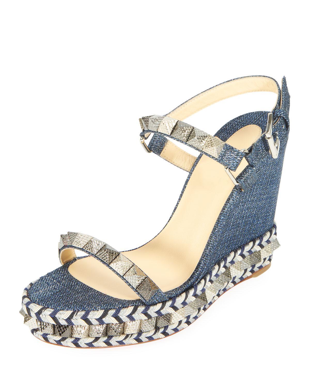 f453a08b284 Christian Louboutin. Women s Blue Pyraclou Spike Denim Wedge Red Sole Sandal