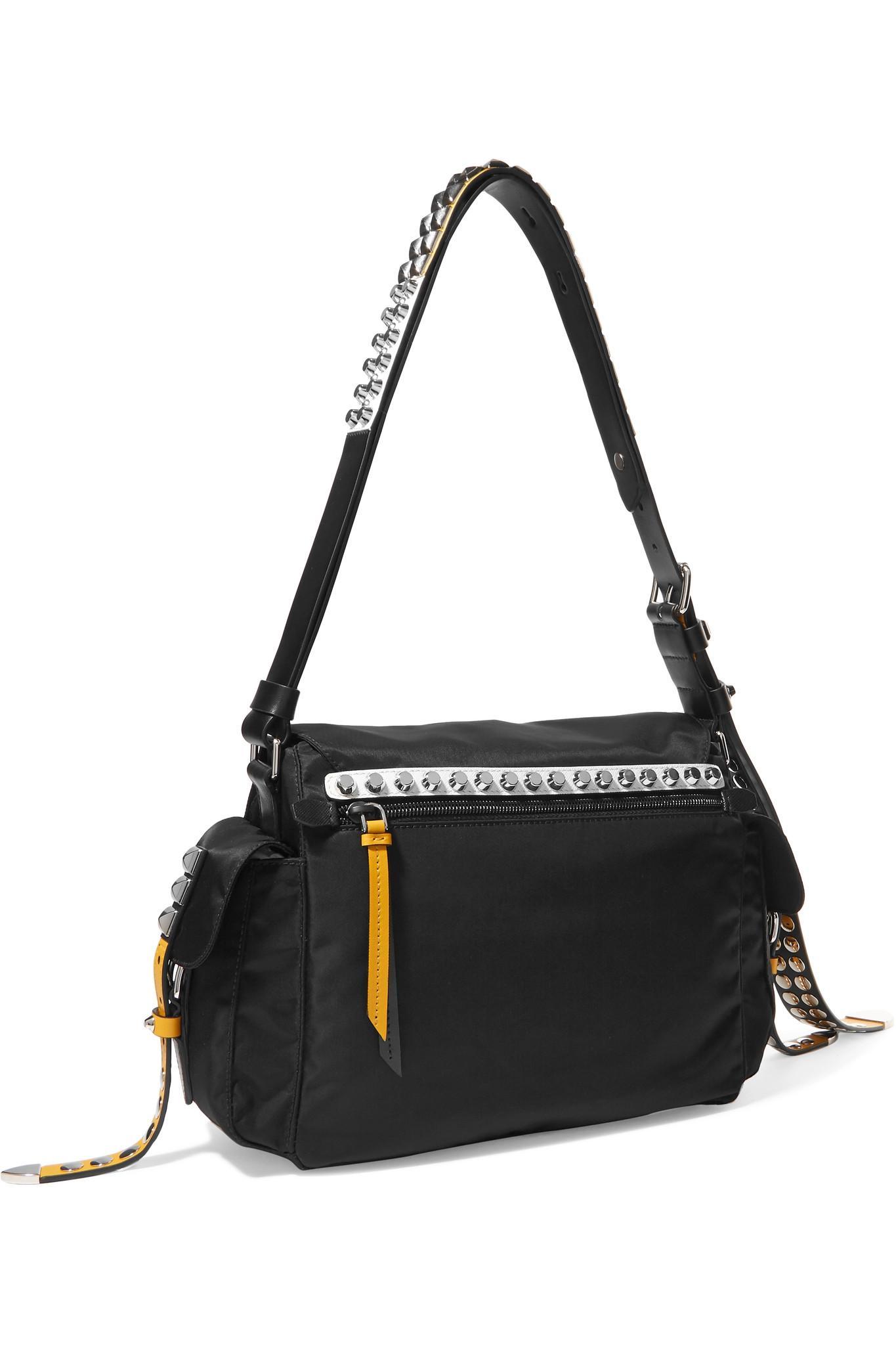 cbec558a25d5 Prada New Vela Studded Leather-trimmed Shell Shoulder Bag in Black ...