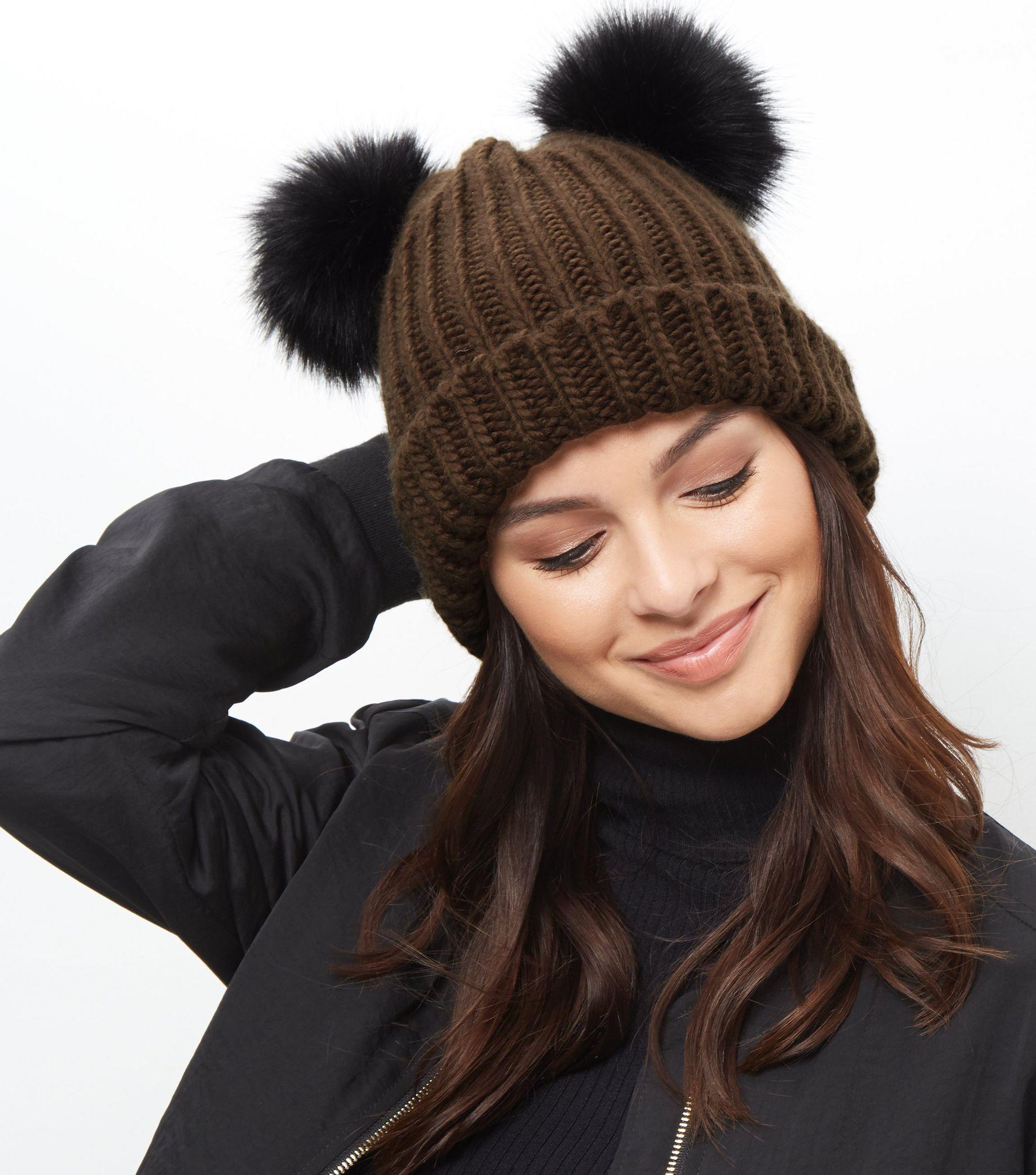 bf035d5be36 New Look Khaki Double Faux Fur Pom Pom Hat - Lyst
