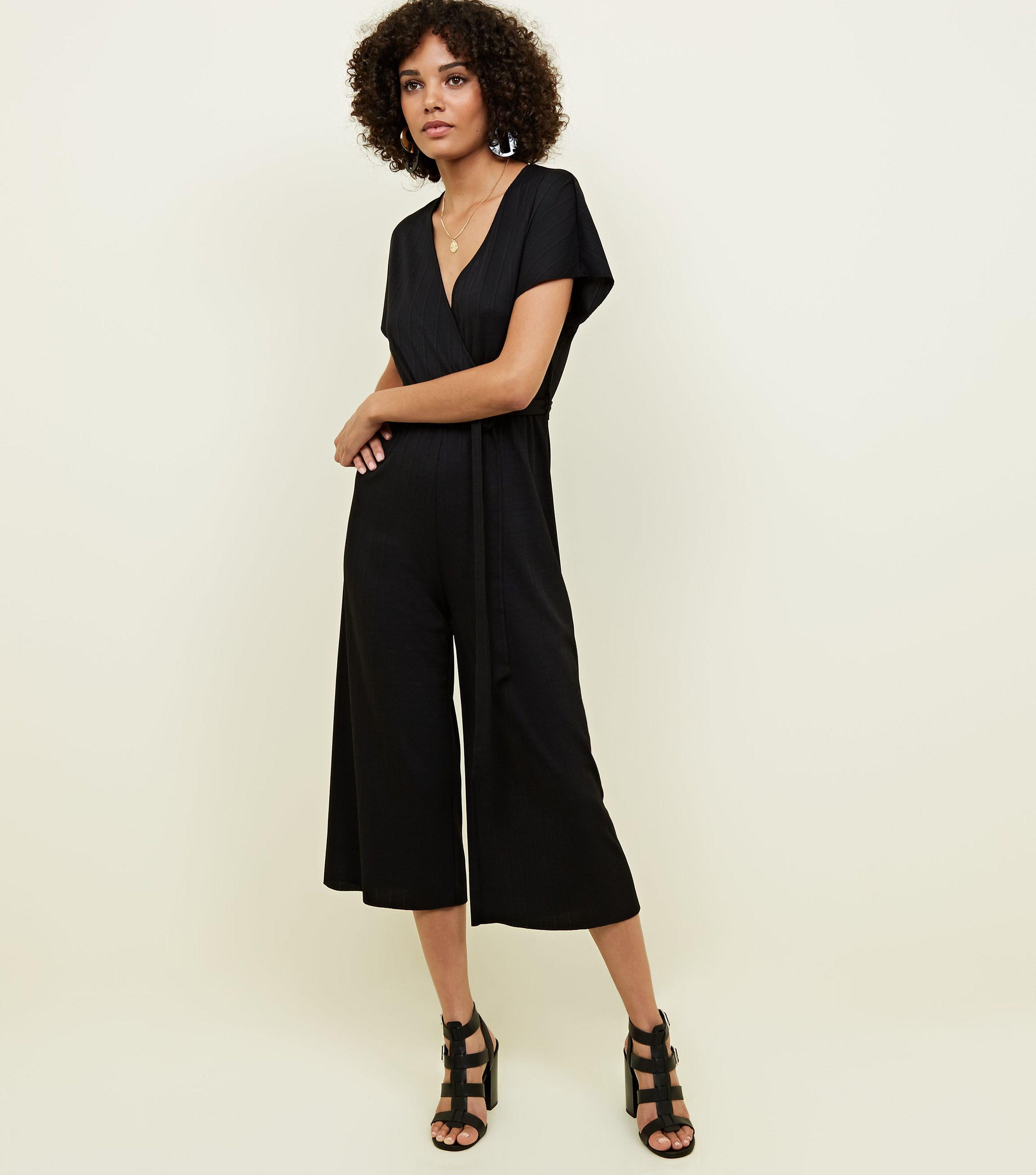 fc604e4a9952 New Look Black Wrap Front Ribbed Jersey Jumpsuit in Black - Lyst