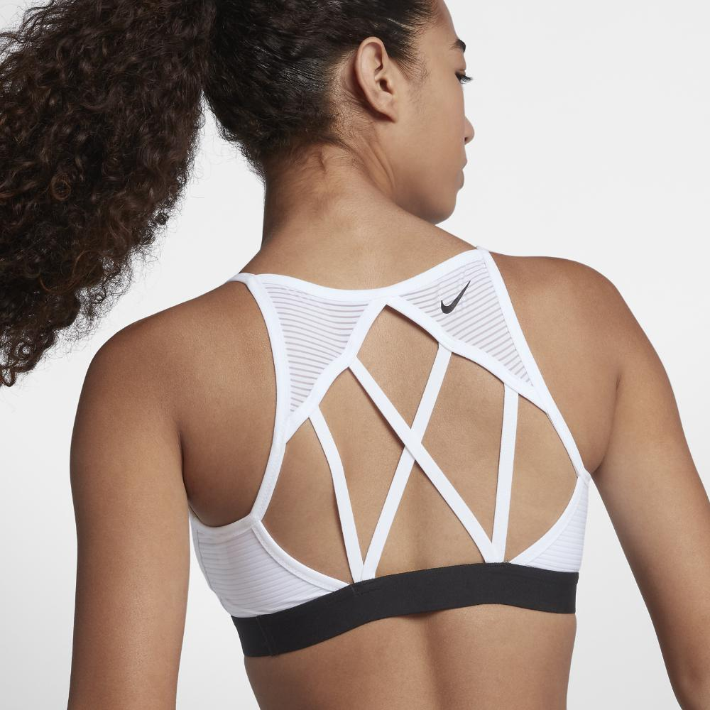 aa3a886d84e99 Lyst - Nike Indy Cooling Women s Light Support Sports Bra in White