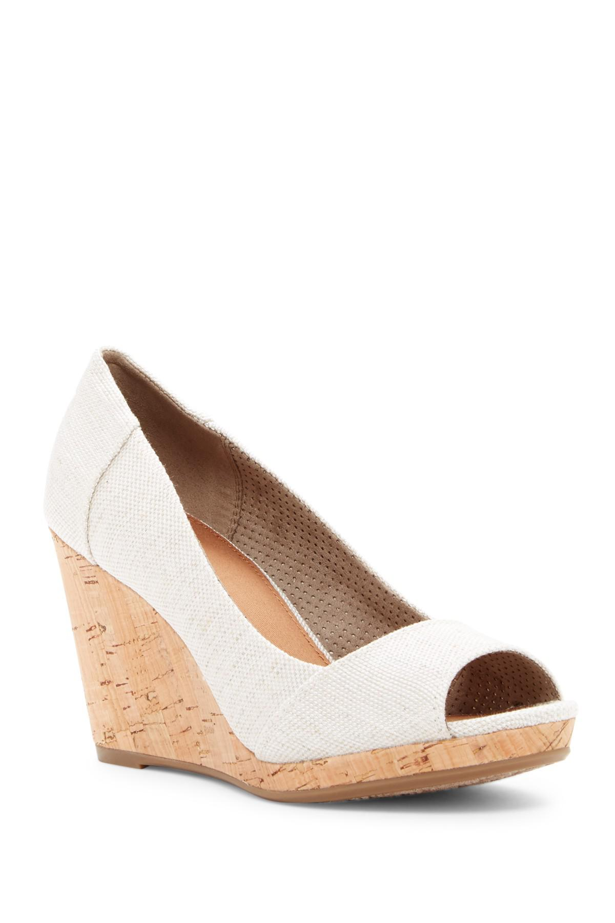2d030164b11 Lyst - TOMS Stella Canvas Wedge Sandal in Natural