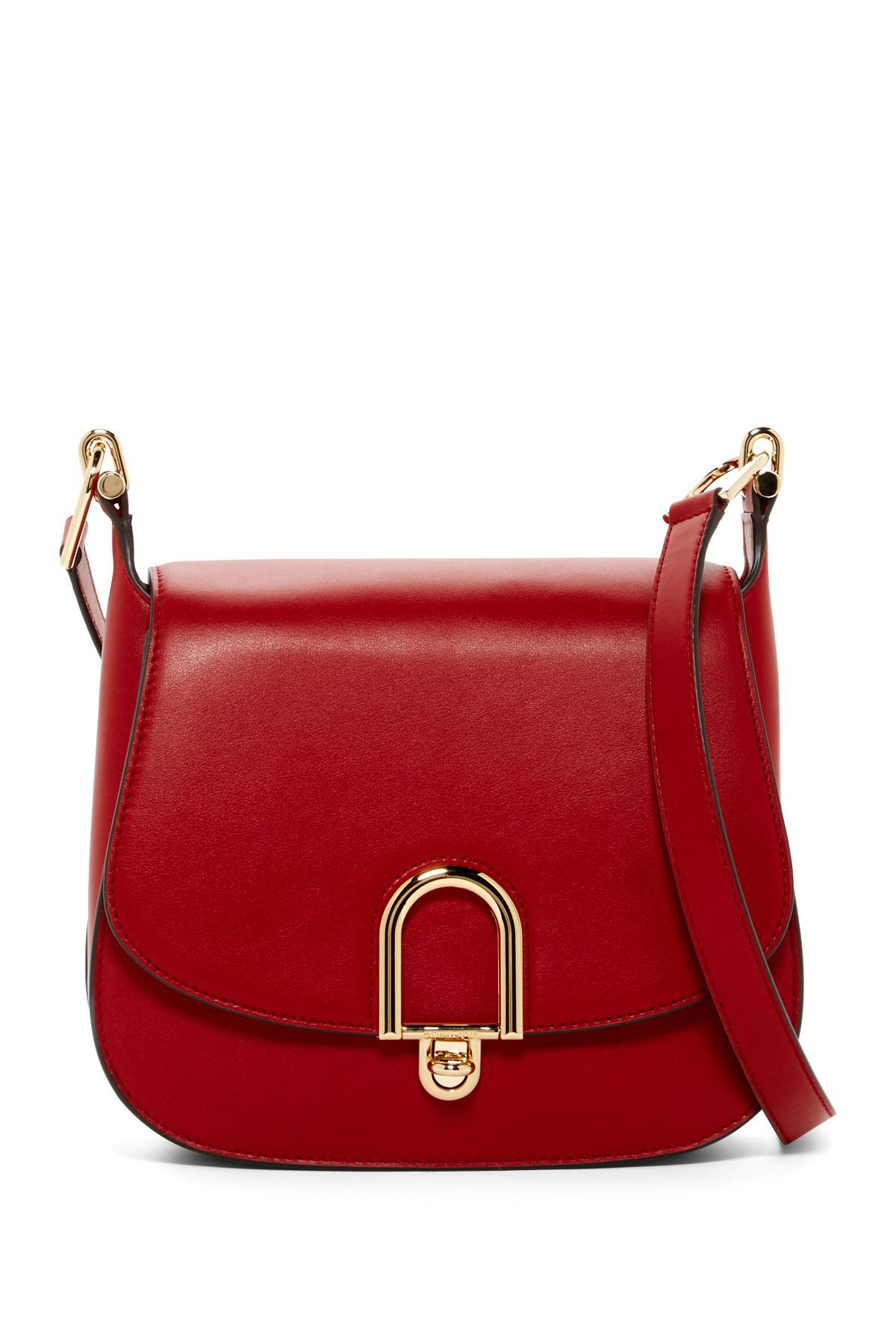 ff7d6f4489a2 Lyst - MICHAEL Michael Kors Delfina Large Leather Saddle Bag in Red