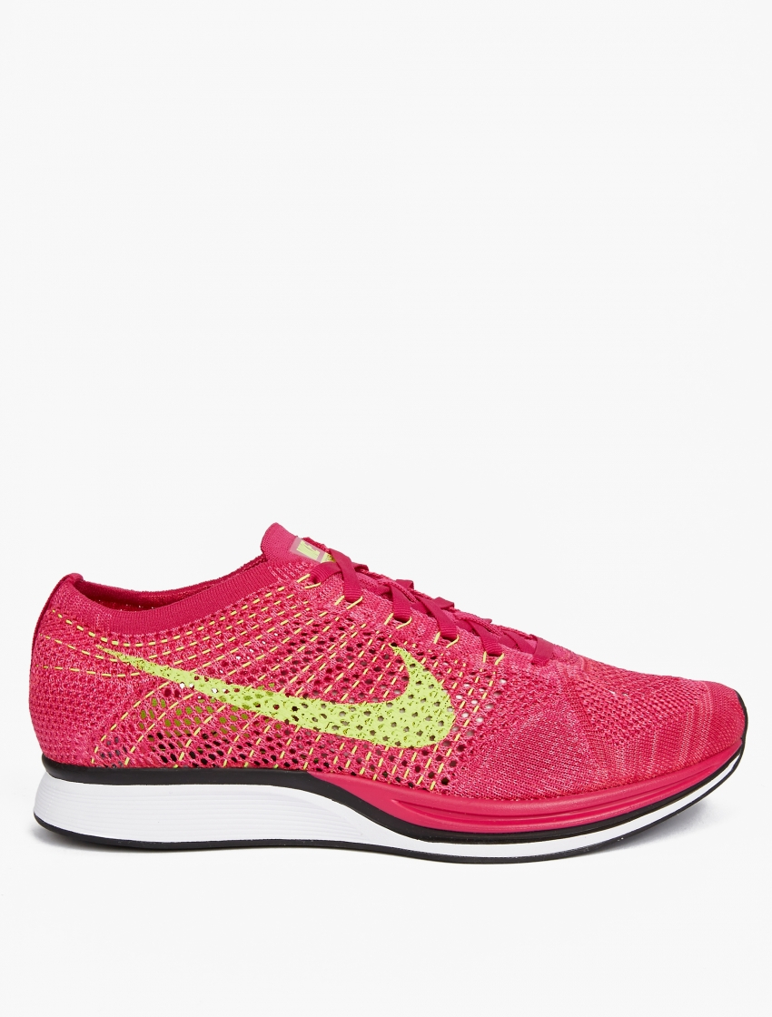 nike pink flyknit racer sneakers in pink for lyst
