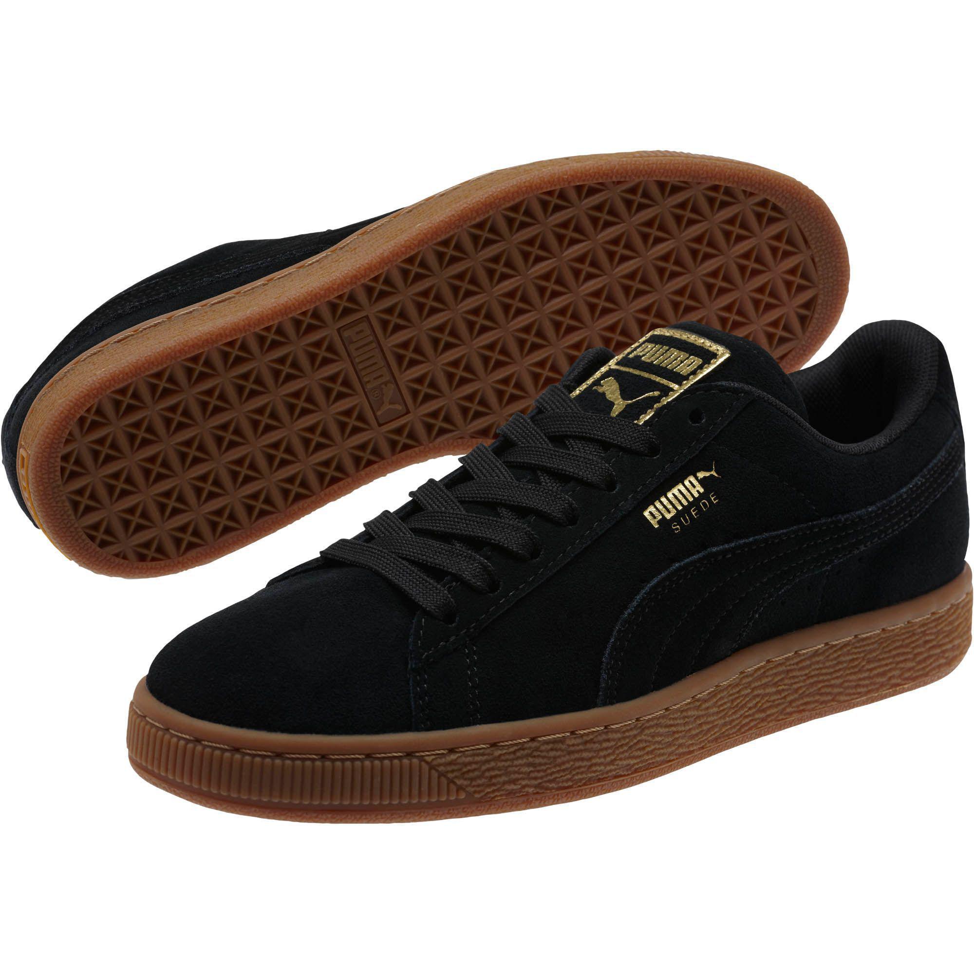 1659c69c2fa9 Lyst - PUMA Suede Classic Gold Women s Sneakers in Black