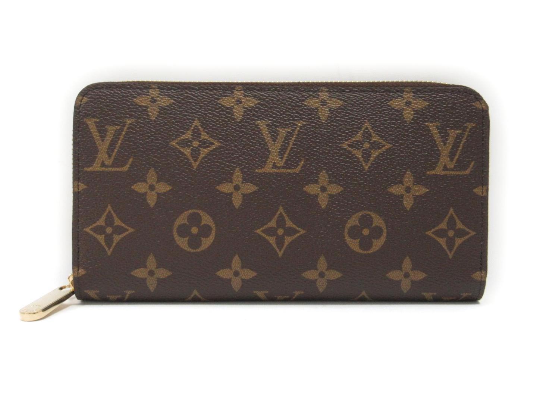 335a9e00d9b7 Lyst - Louis Vuitton Monogram Brown Fuchsia Zip Around Zippy Wallet ...