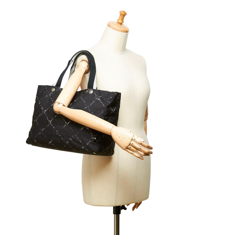 aff8bdea590e7f Chanel Travel Line Tote Bag | The Shred Centre