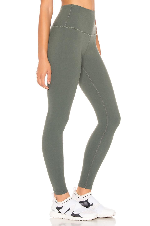 1440e289665b38 Beyond Yoga - Green Caught In The Midi High Waisted Legging - Lyst. View  fullscreen