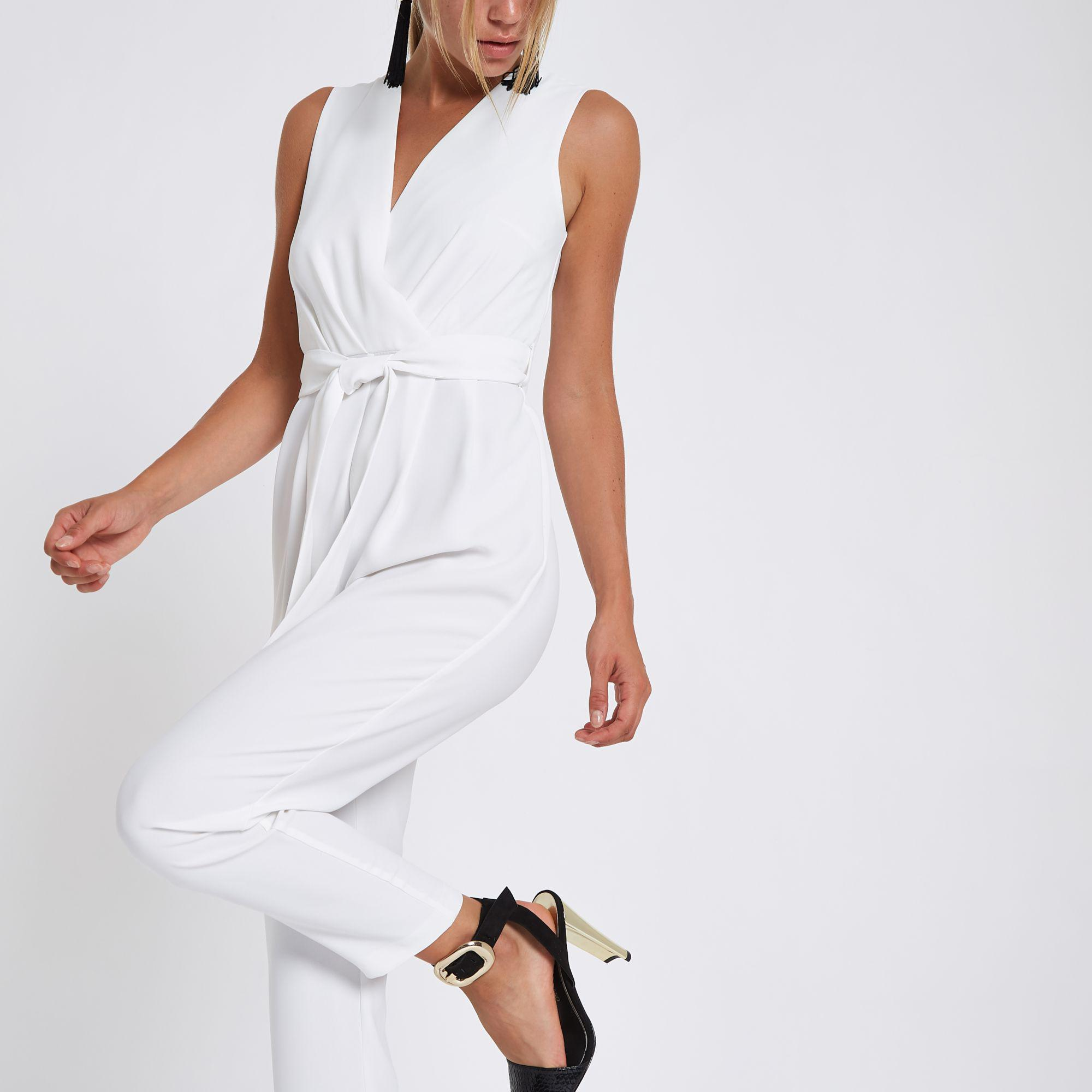 11ad5ca36a2d Lyst - River Island Wrap Front Tie Waist Jumpsuit in White