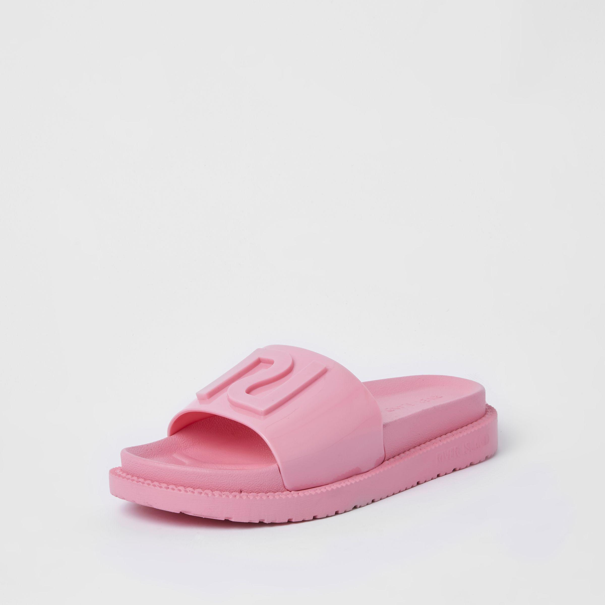 a8bc195cc0af Lyst - River Island Pink Ri Branded Jelly Sliders in Pink