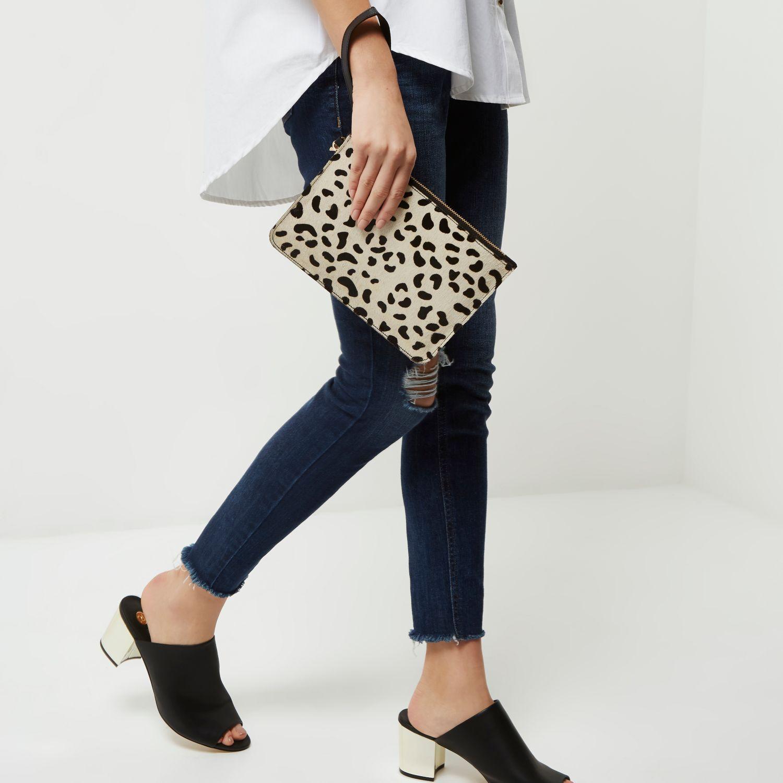 Lyst - River Island Cream Leopard Print Pony Skin Clutch Bag in Black 285bab4a09544