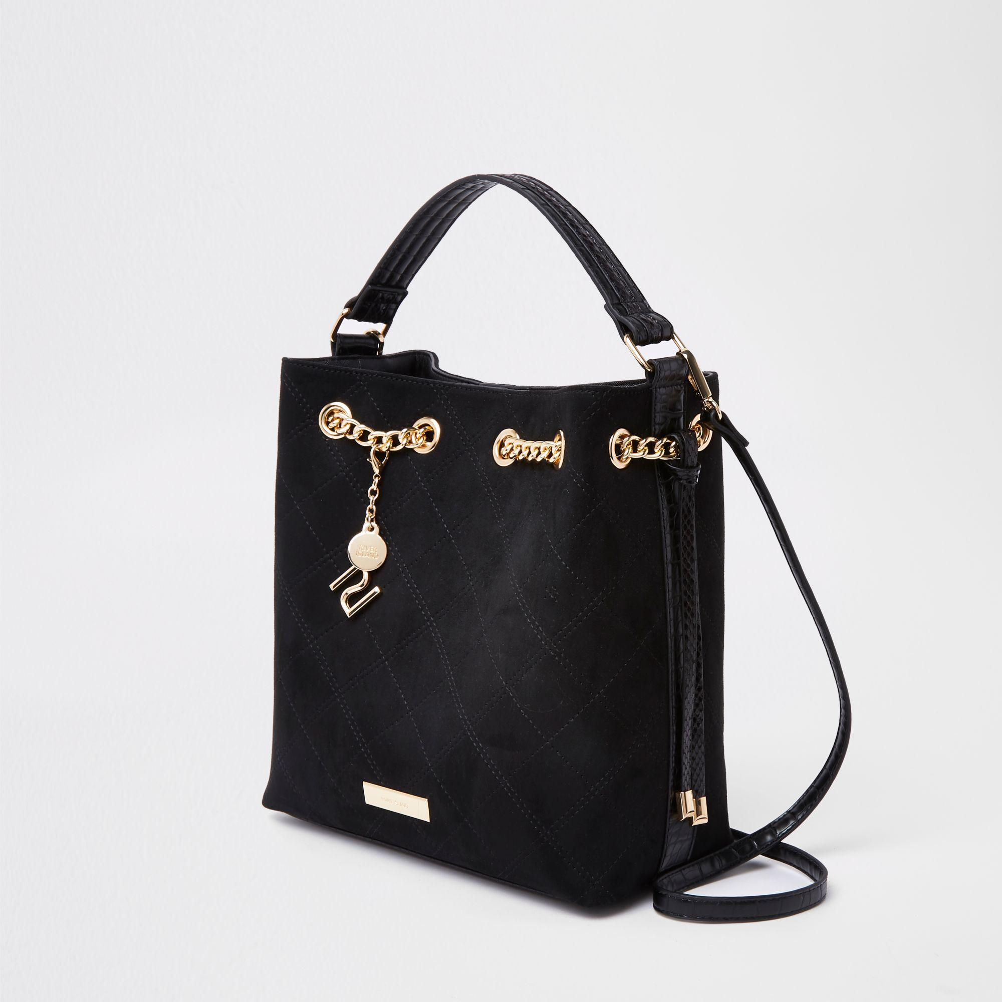 6fc0893ecf Lyst - River Island Chain Quilted Bucket Bag in Black