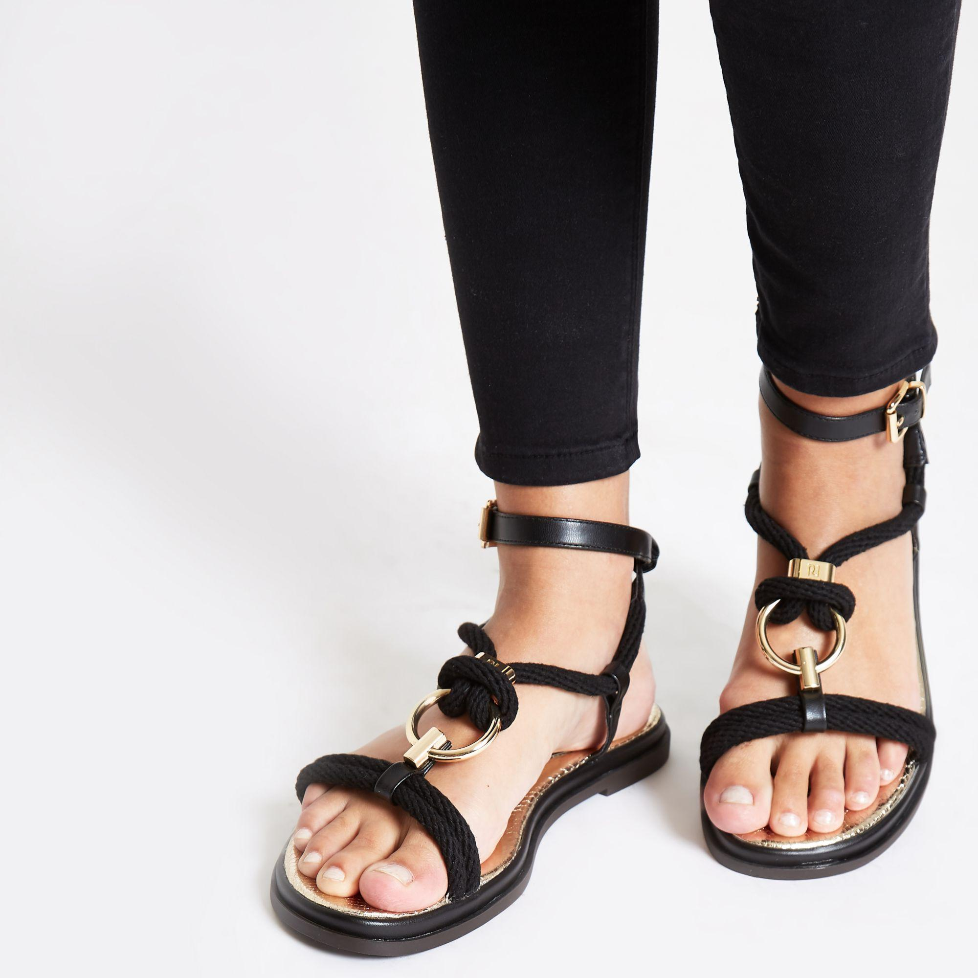 a69c7c95ba0 ... Black Ring Rope Flat Sandals - Lyst. View fullscreen
