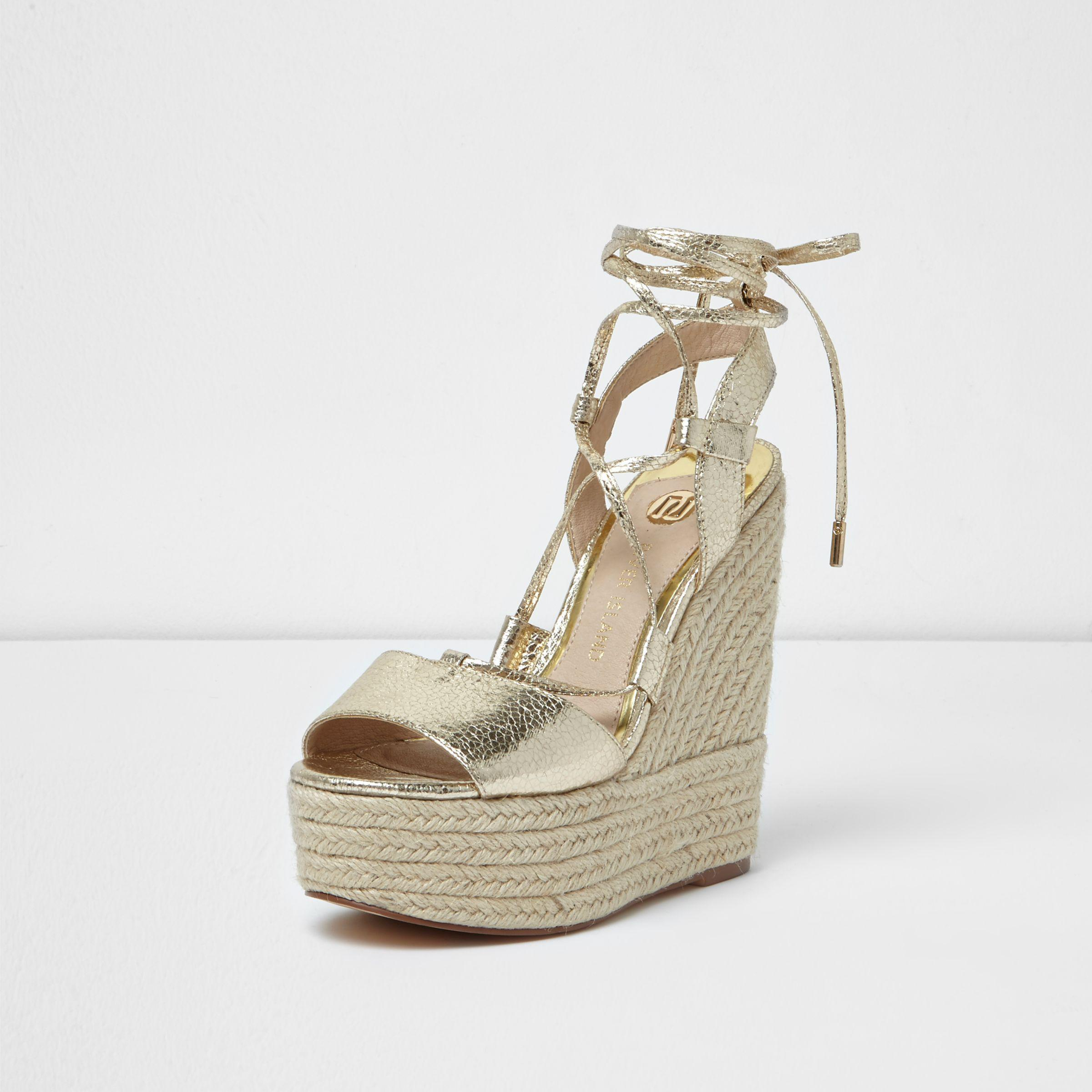 fc58cea7fe6 Lyst - River Island Gold Wide Fit Tie Espadrille Platform Wedges in ...