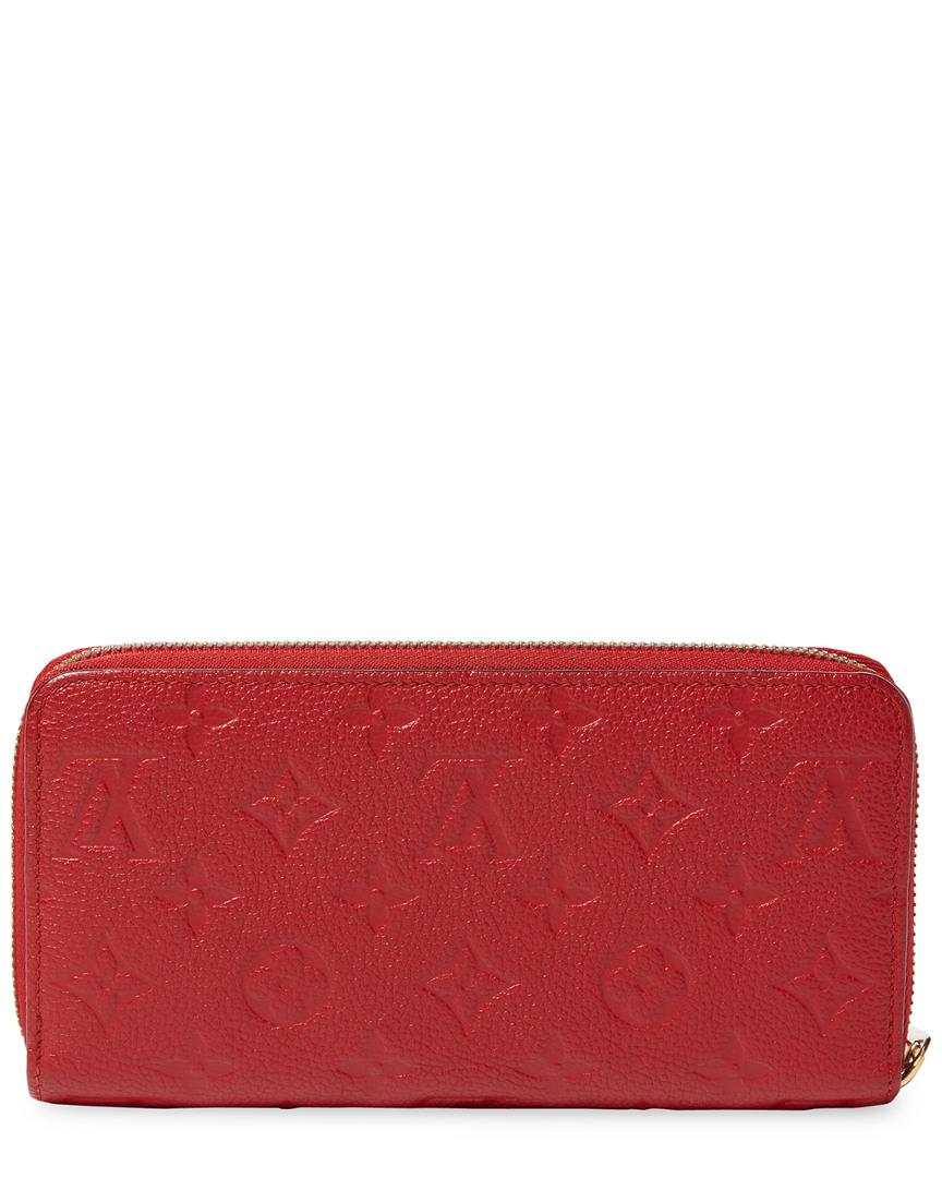 Lyst - Louis Vuitton Red Monogram Empreinte Leather Zippy Wallet in Red 5d0a97cc0