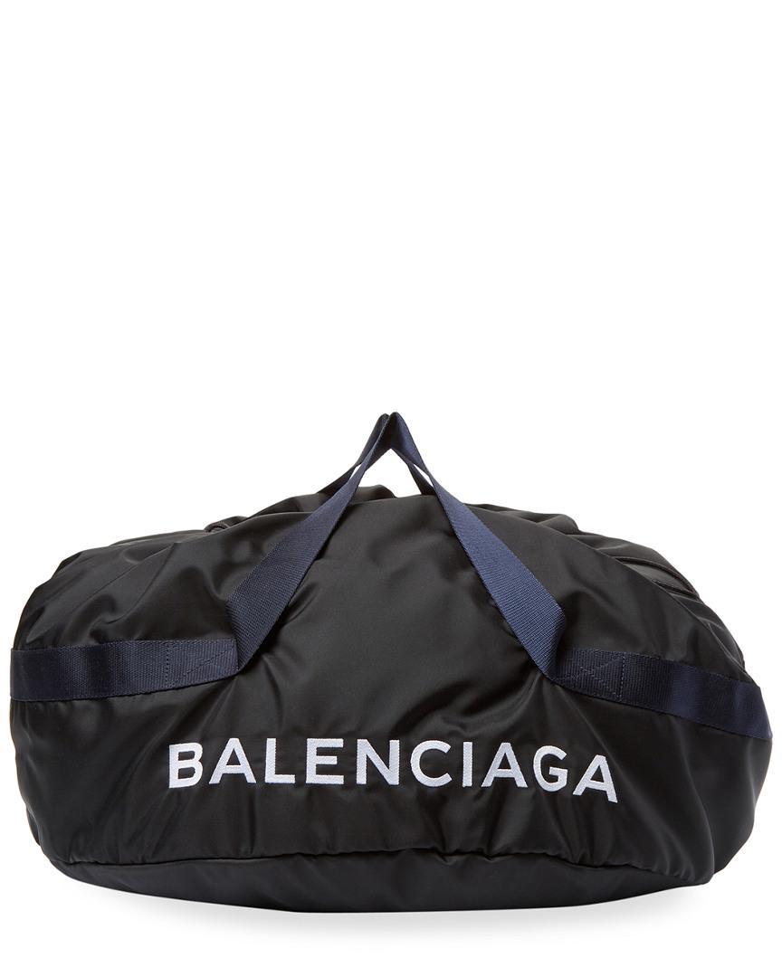 ffb51596c5d4 Lyst - Balenciaga Wheel Bag Medium Nylon Duffle in Black