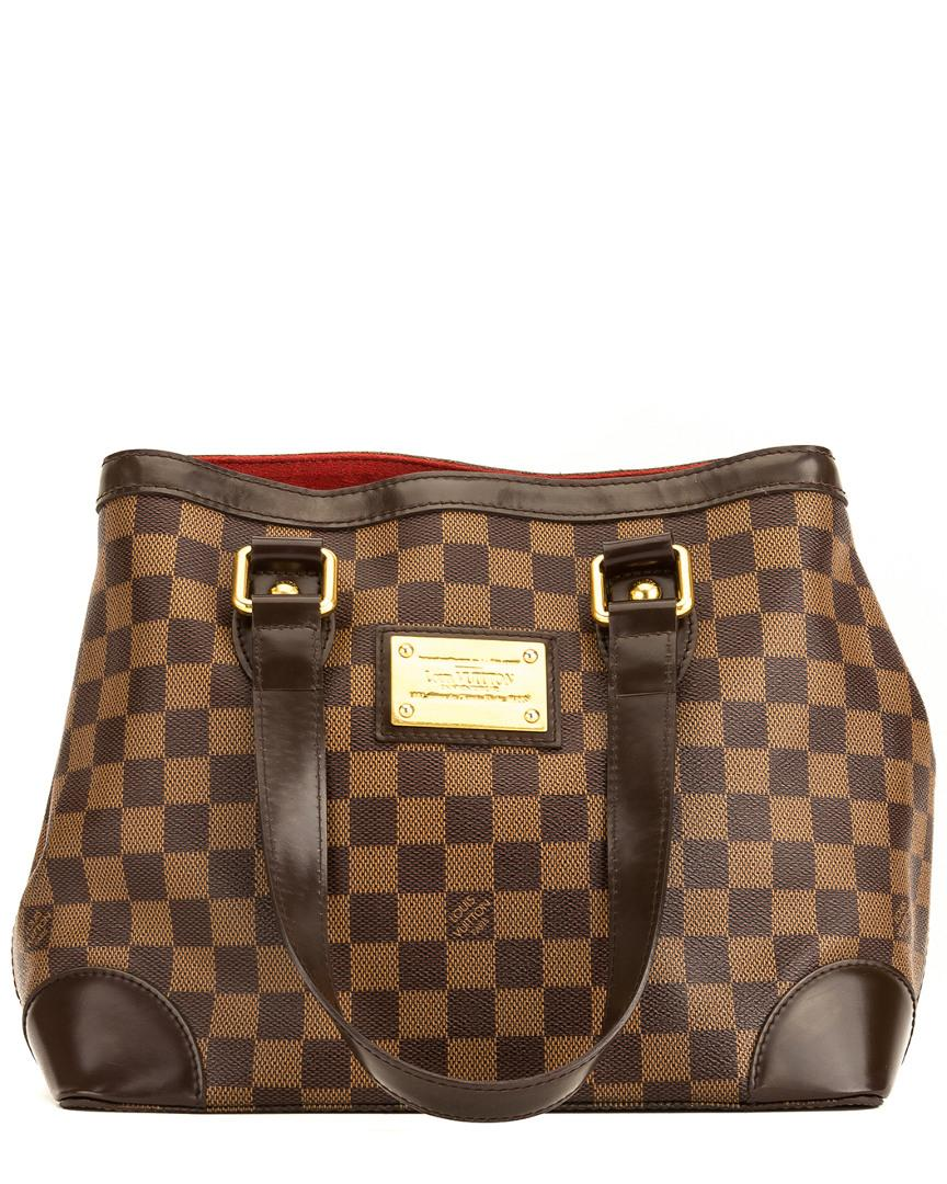 b84df2a16f68 Lyst - Louis Vuitton Damier Ebene Canvas Hampstead Pm in Brown