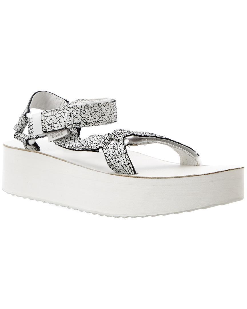 2d7f8d44d3f Lyst - Teva Women s Flatform Universal Crackle Leather Sandal in White