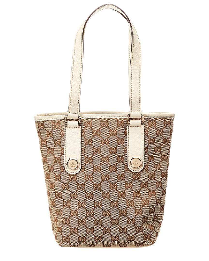 706c06c7bcc Gucci Brown GG Canvas   Creme Leather Charmy Tote in Brown - Save ...