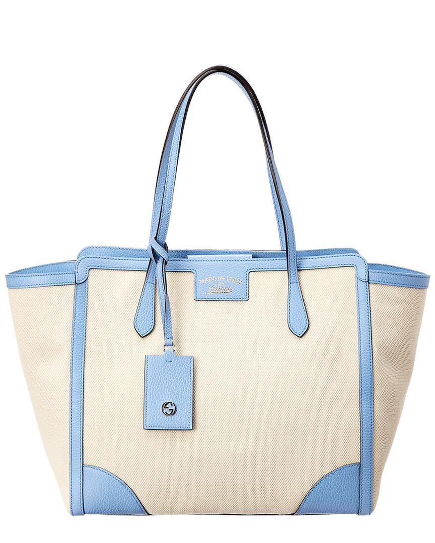 e17cc9bc89 Gucci. Women s Cream Canvas   Blue Leather Swing Tote. £769 From Rue La ...
