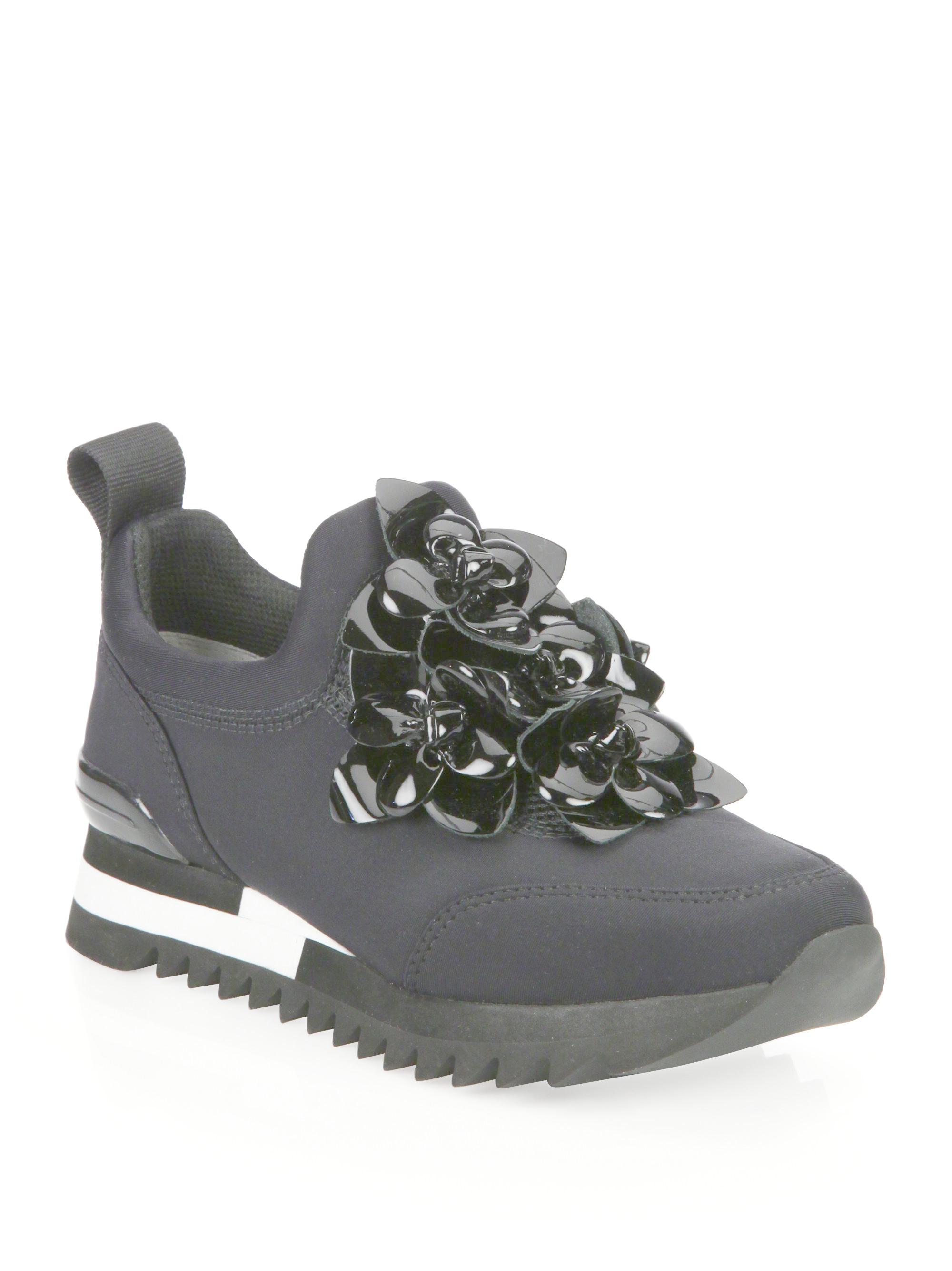 7160a0636b16 Lyst - Tory Burch Blossom Neoprene Sneakers in Black