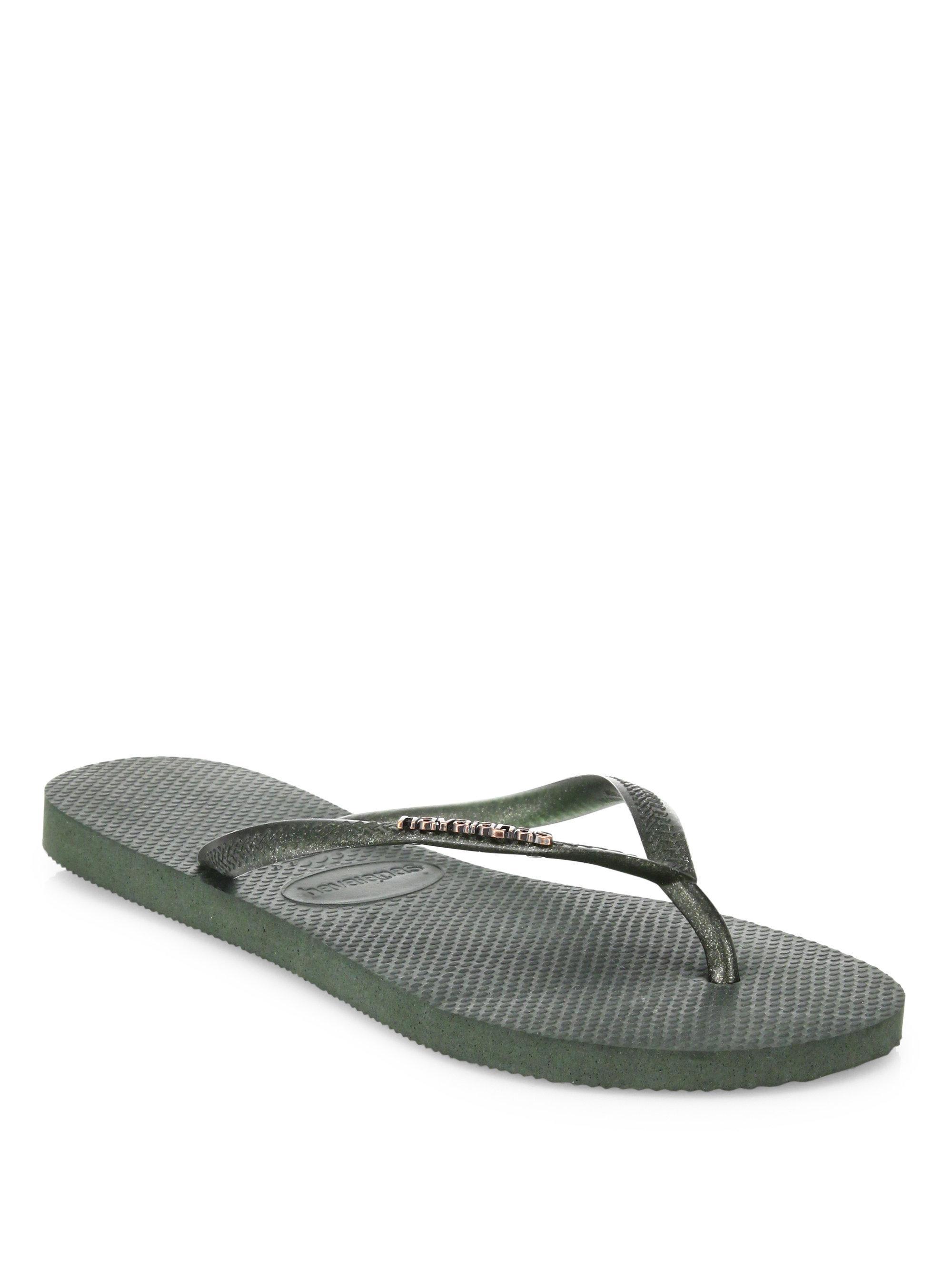 87aebe7ee Lyst - Havaianas Slim Logo Metallic Glitter Flip Flops in Green