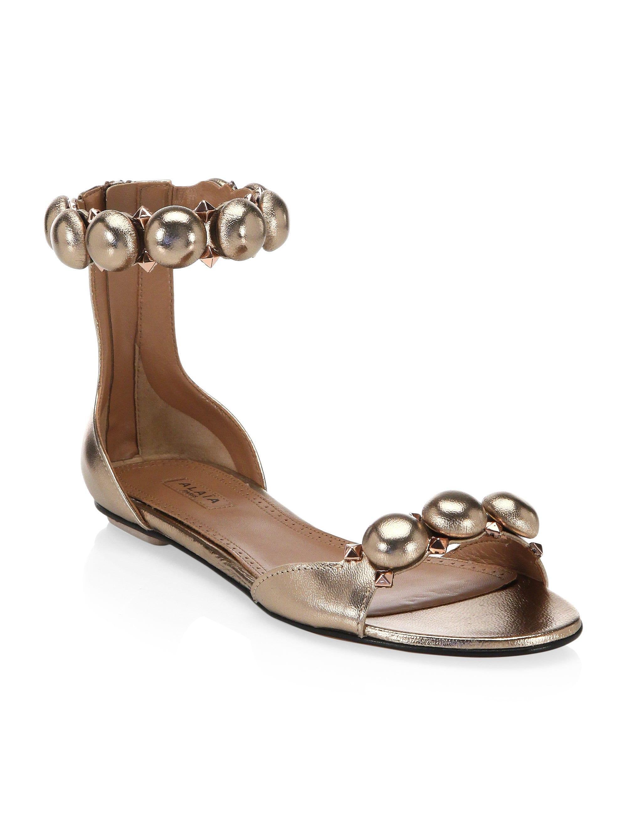 188a4f246bfcb Alaïa Studded Leather Sandals in Metallic - Lyst
