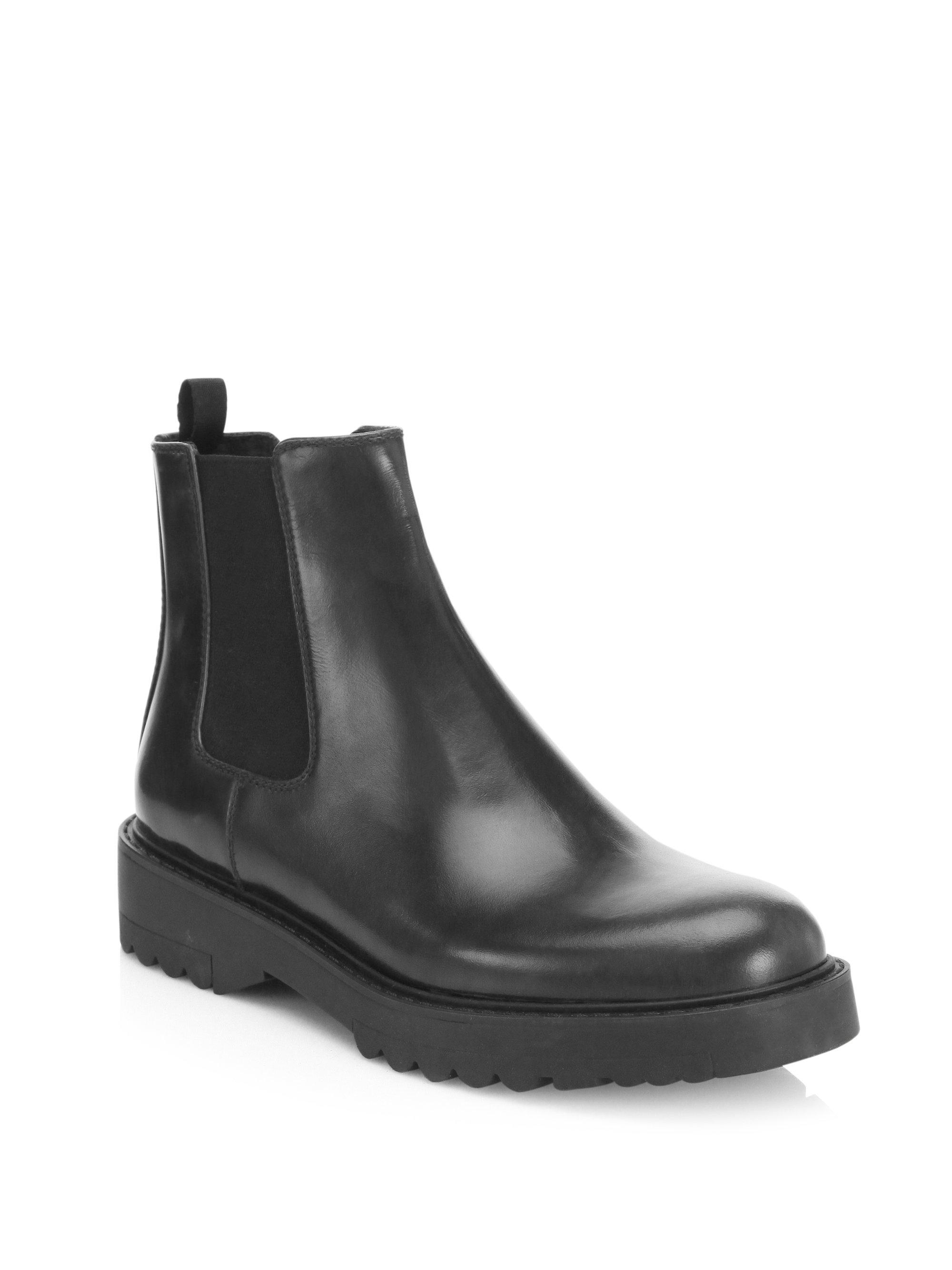 6406da6c98e2 Lyst - Prada Lug Sole Leather Chelsea Booties in Black
