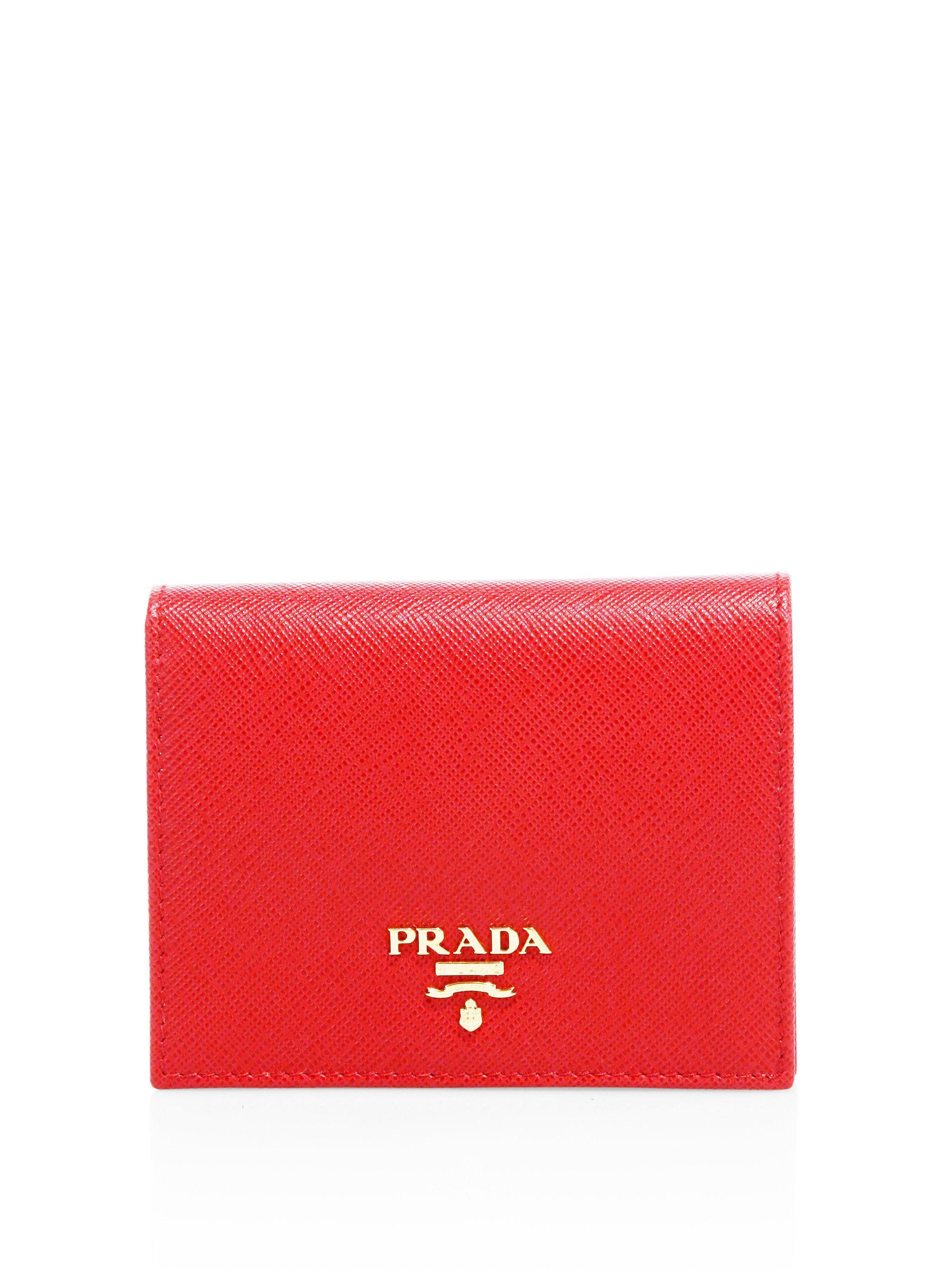 2deed98790fb ... where to buy prada red mini saffiano leather bifold wallet lyst. view  fullscreen 90055 adfc7