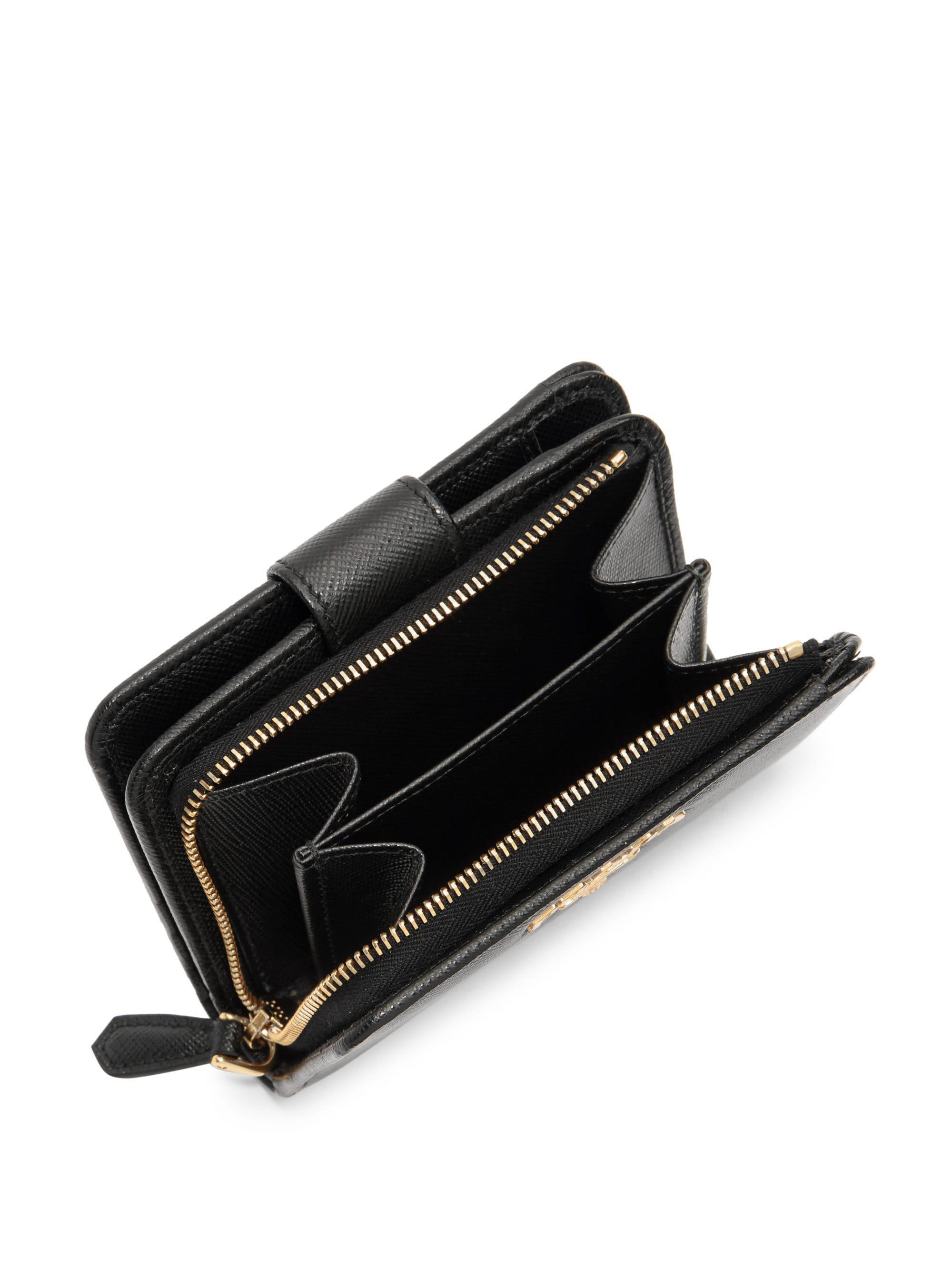83c795417123 ... greece prada small saffiano leather tab wallet in black lyst 0a9fd c4bee