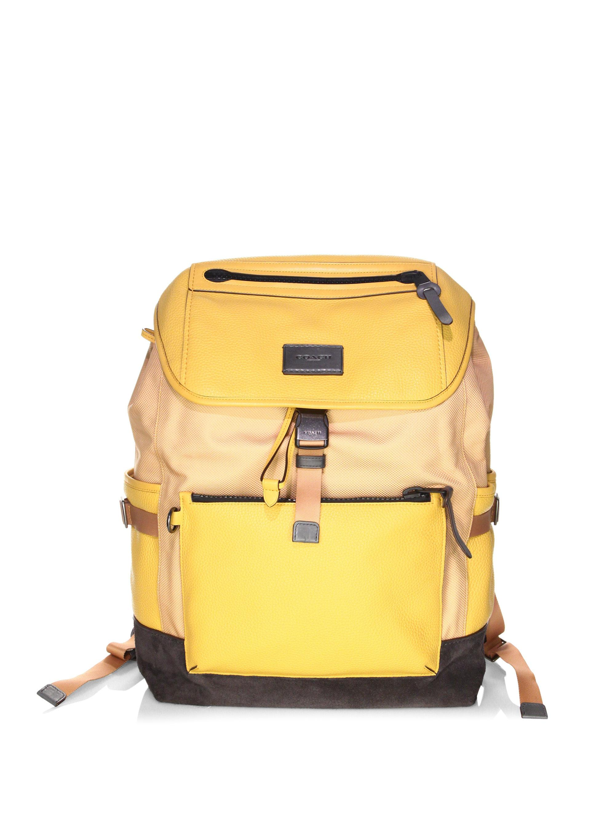 15df6aed9697 ... good lyst coach manhattan backpack in yellow for men 2b6bf 4f56e