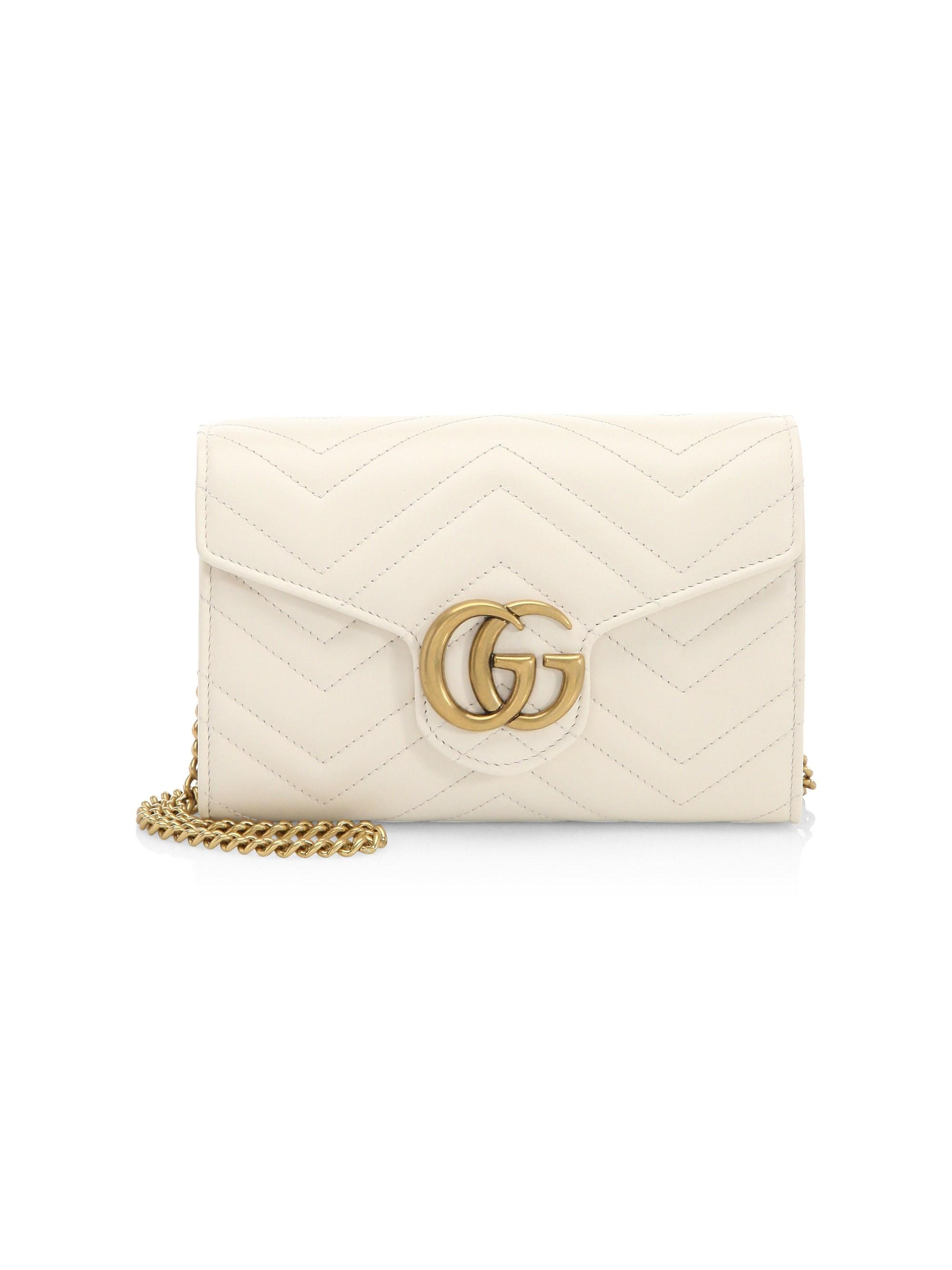 94c9730fd224 Gucci. White Women's GG Marmont Leather Mini Bag - Black. $1,450 From Saks  Fifth Avenue