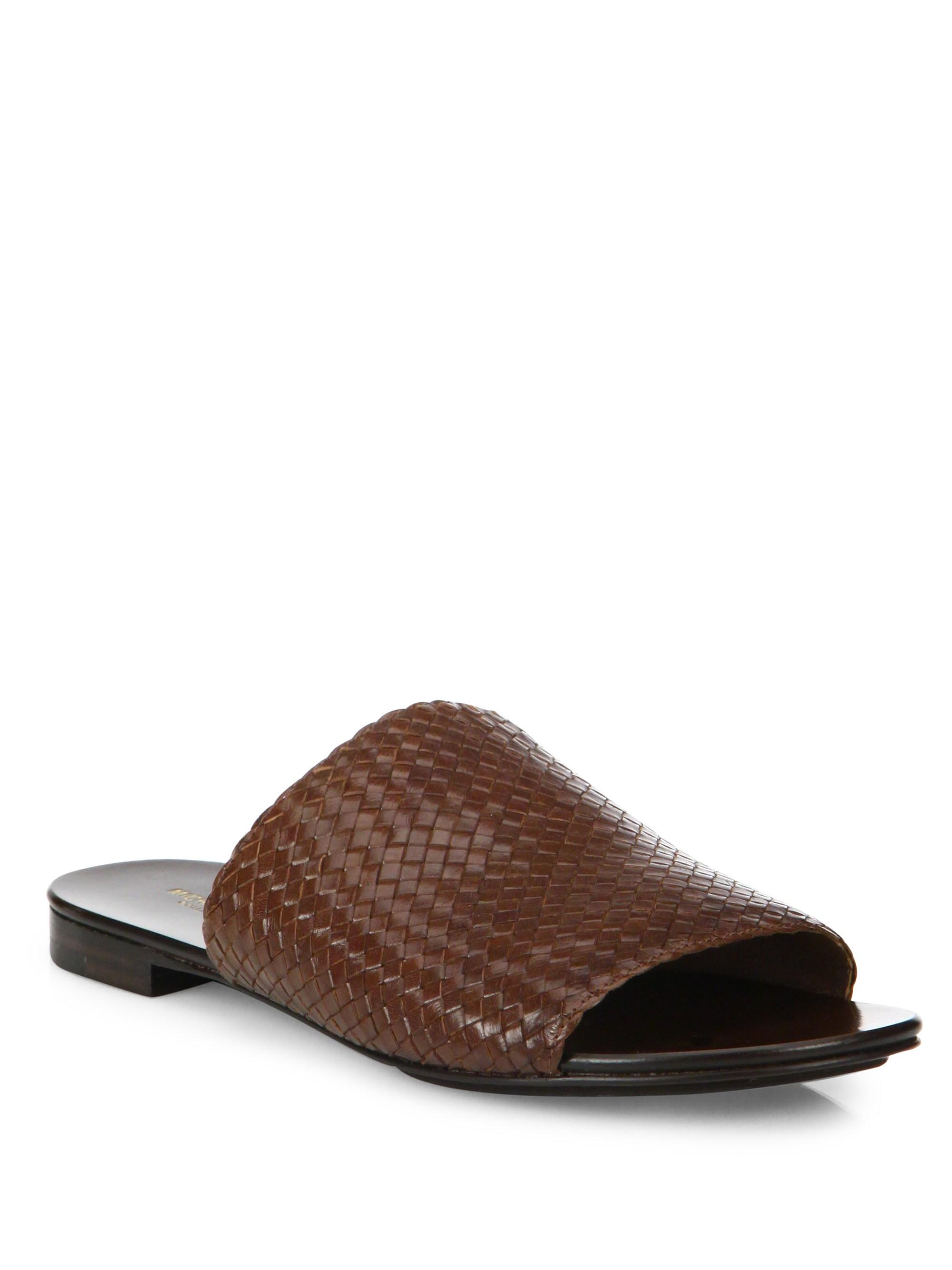 d97b4526dd09 Michael Kors. Women s Brown Byrne Woven Leather Slides.  395  158 From Saks  Fifth Avenue