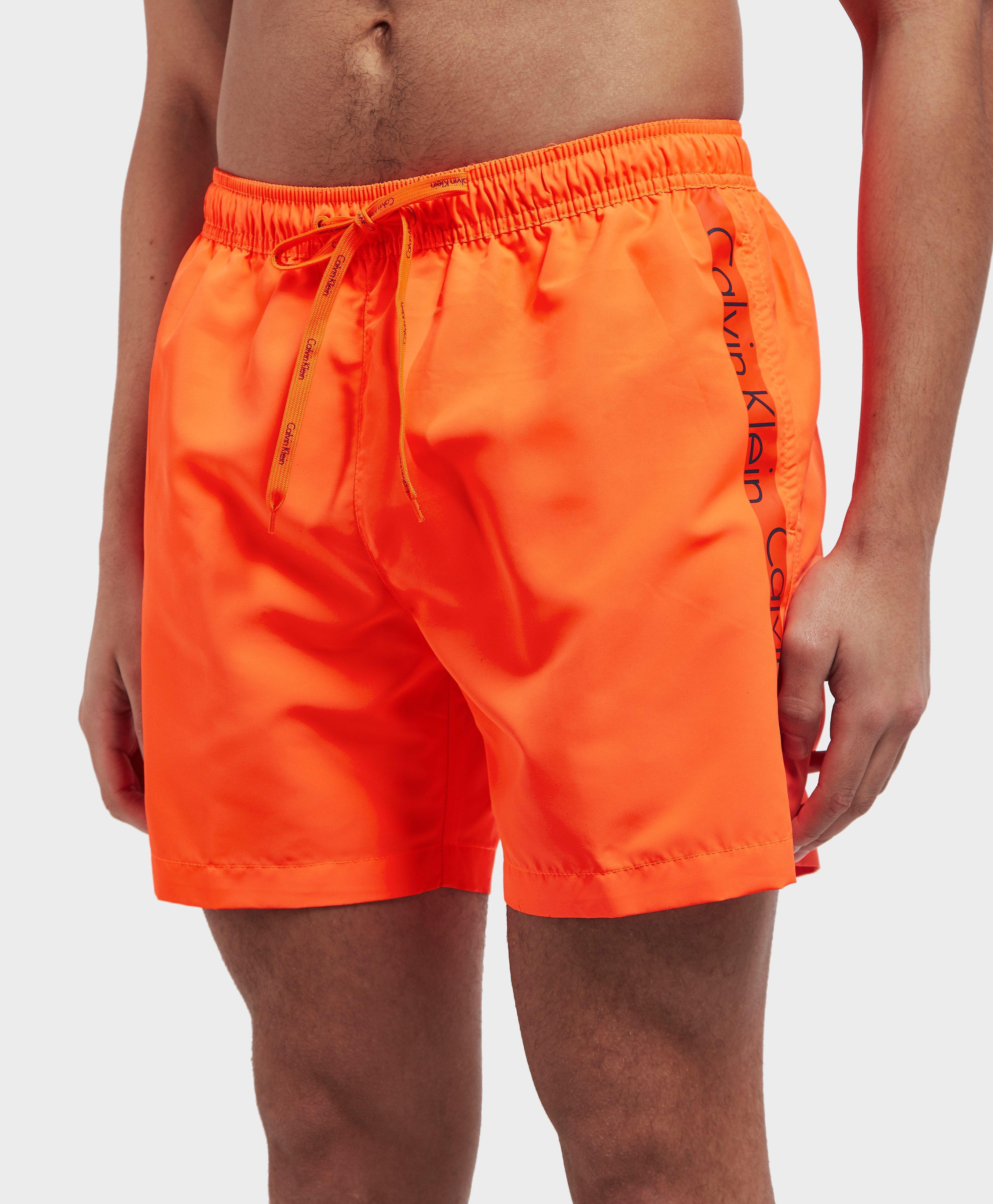 50fe6280518 Calvin Klein Side Logo Swim Shorts in Orange for Men - Lyst
